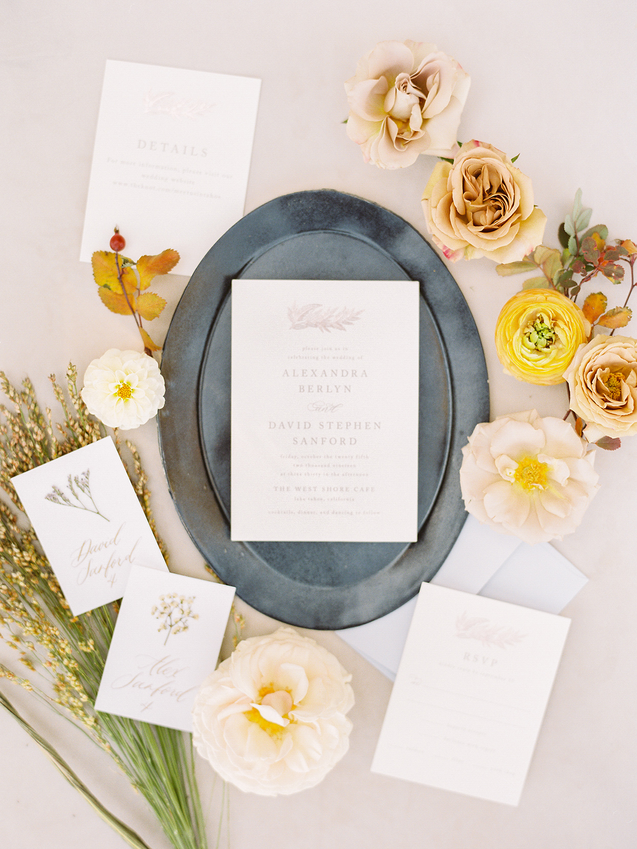 alexandra david wedding invites on gray platter with flowers