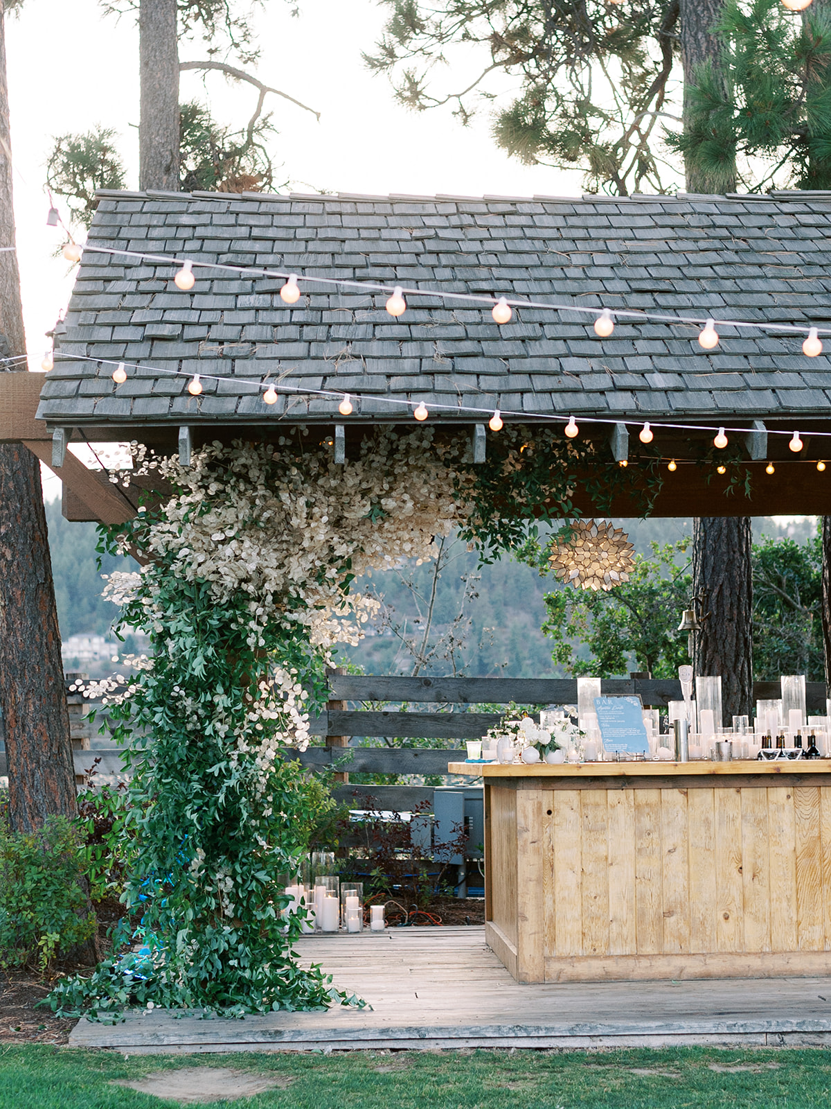 outdoor wedding bar area with hanging string lights