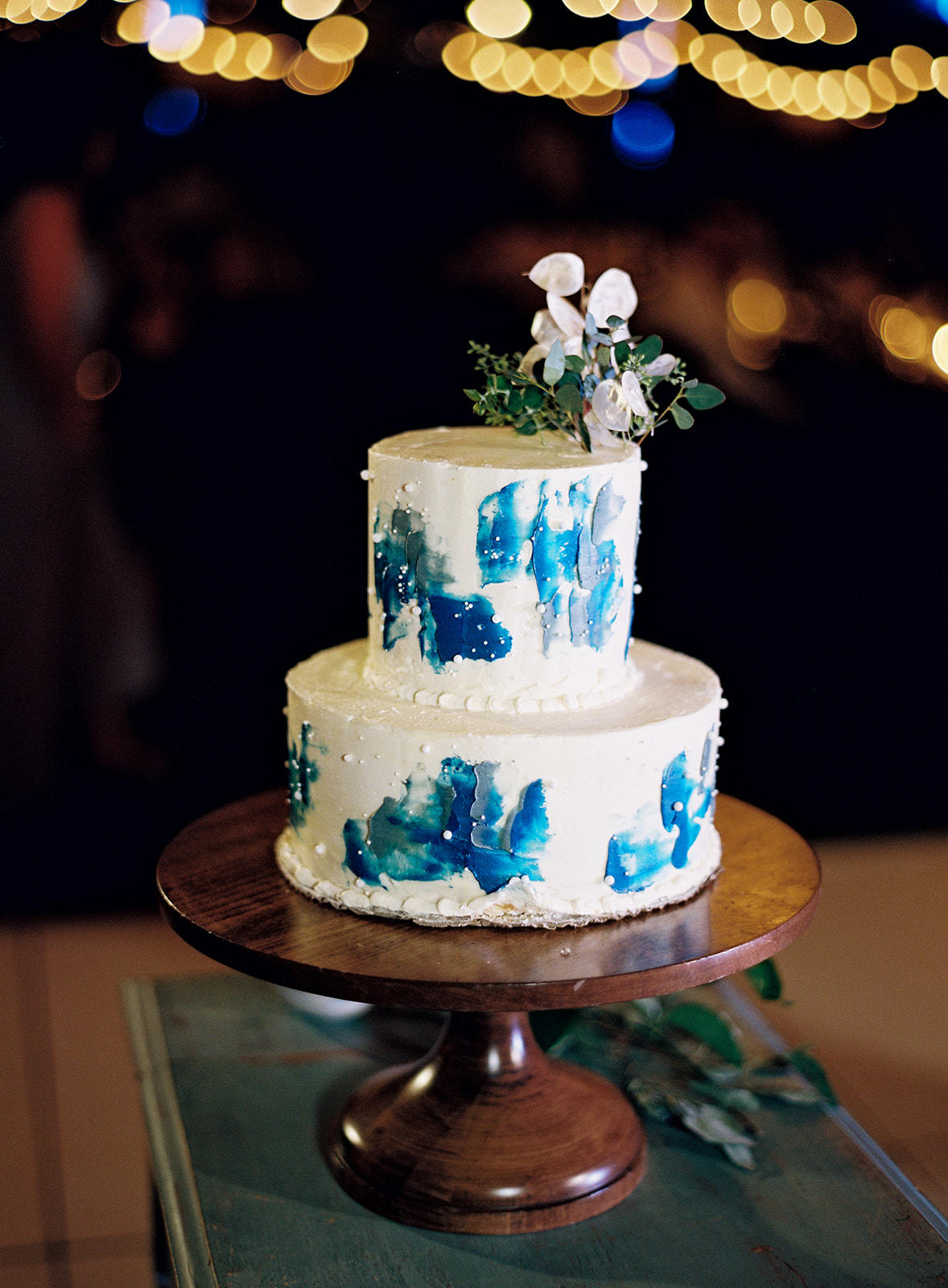 two tier white and blue frosted wedding cake