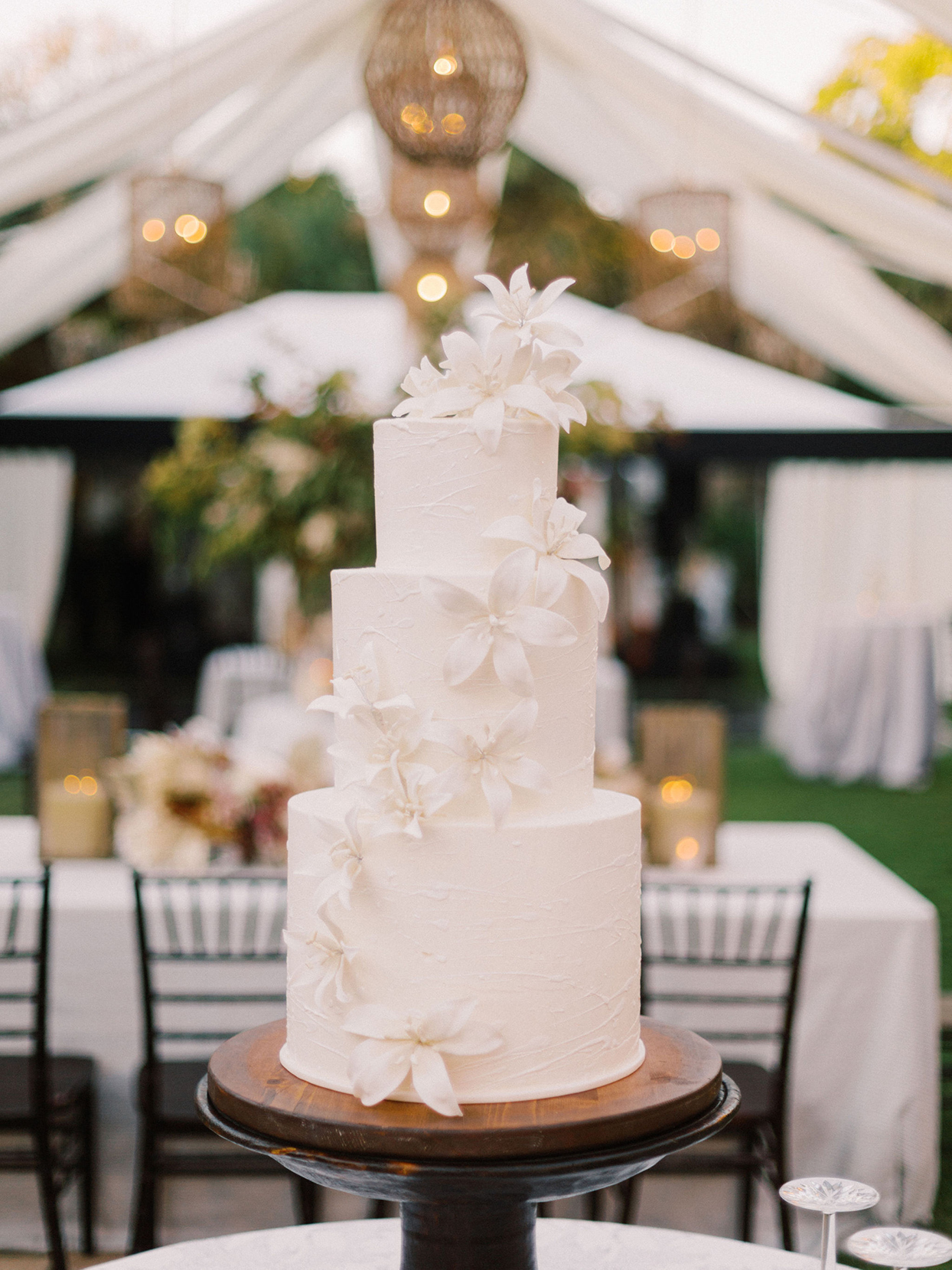 megan parking simple white wedding cake with flowers