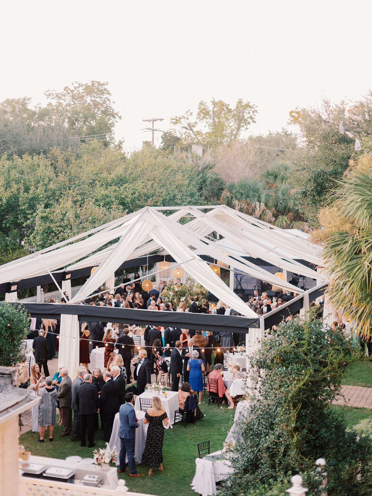 megan parking wedding tent filled with mingling guests
