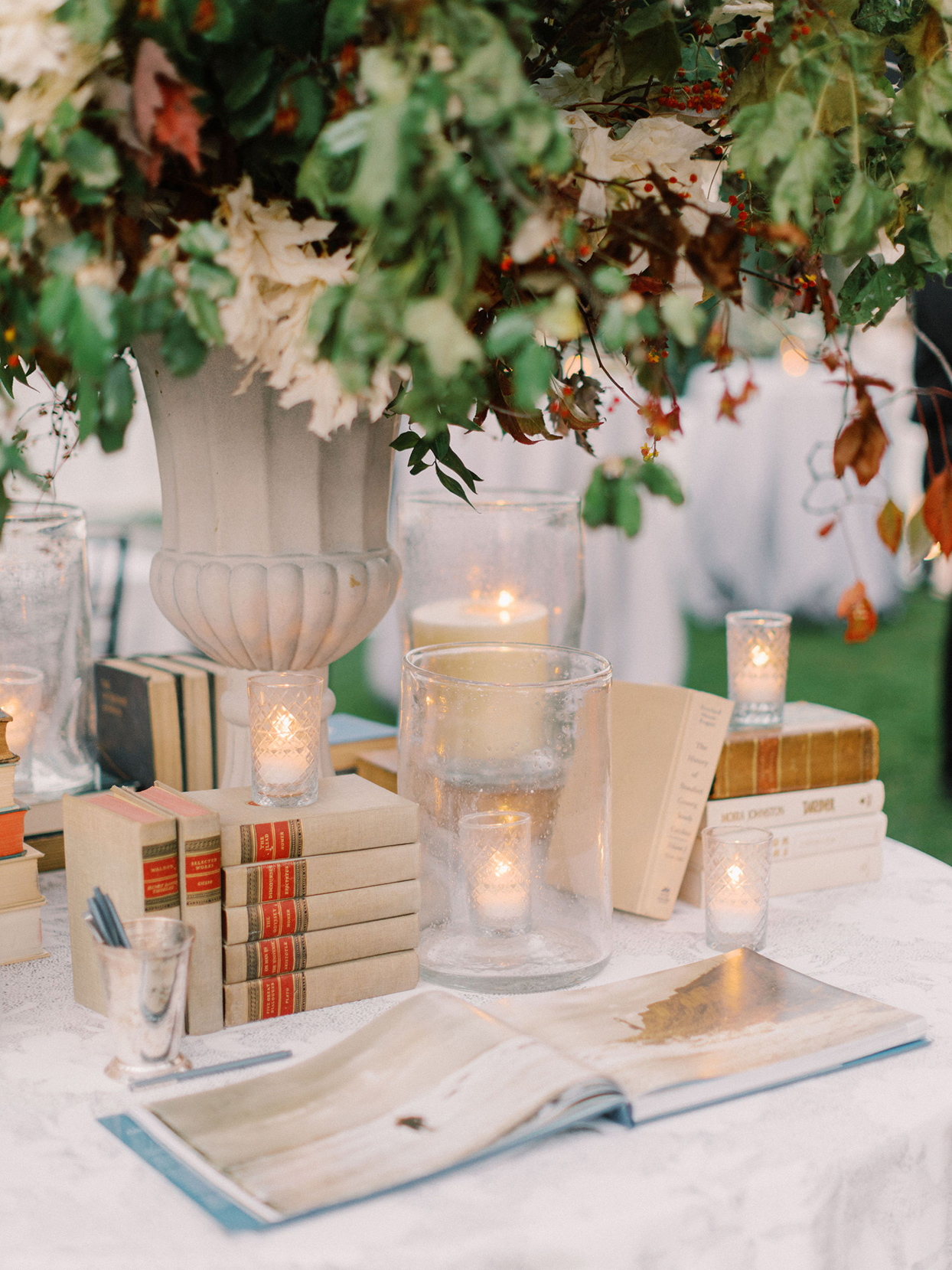 megan parking wedding guest book table with decorative antique books