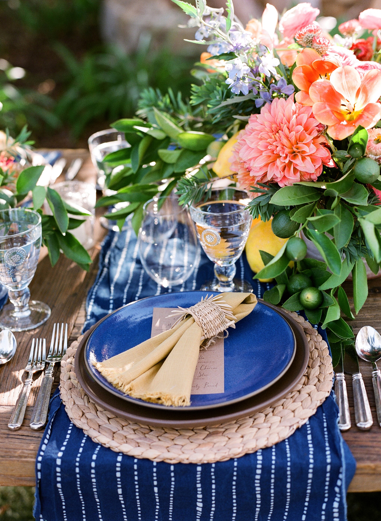 blue and tan themed rehearsal dinner place setting