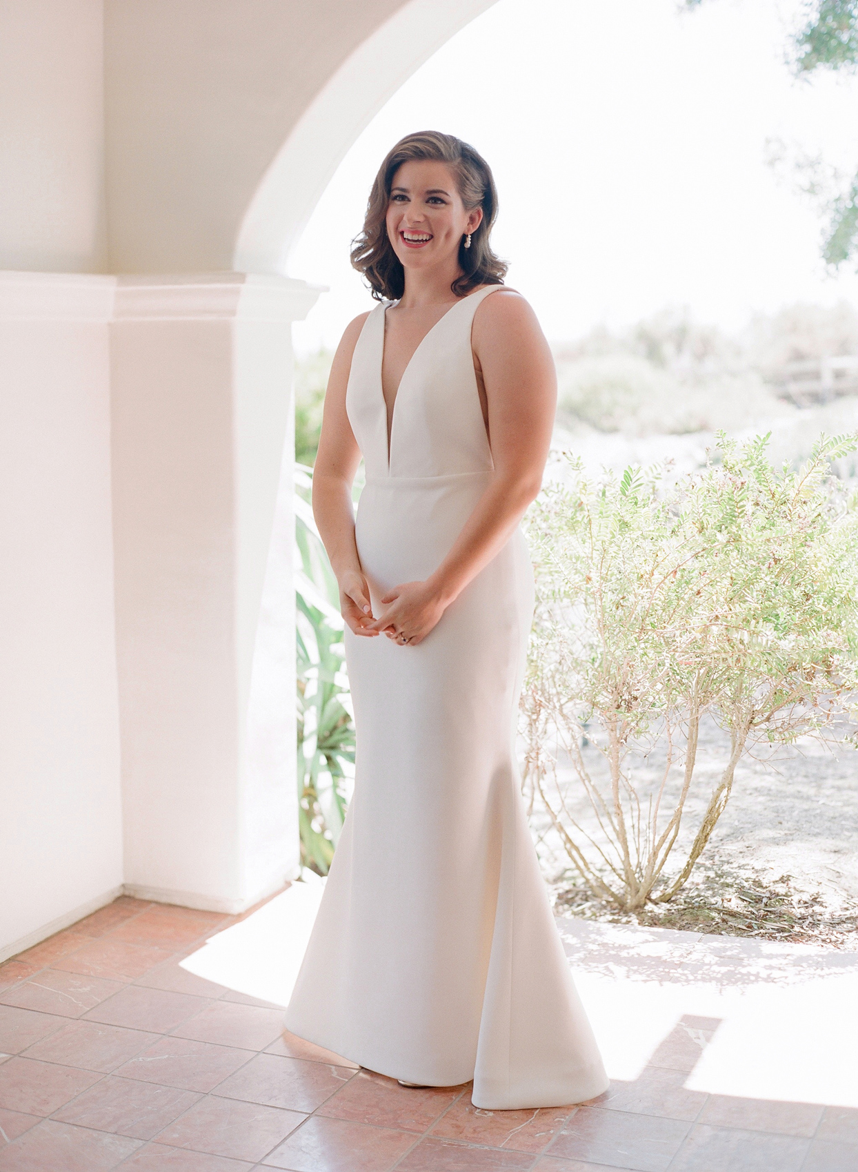 bride wearing deep v-neck sleeveless silk and satin Ramona Keveza wedding dress