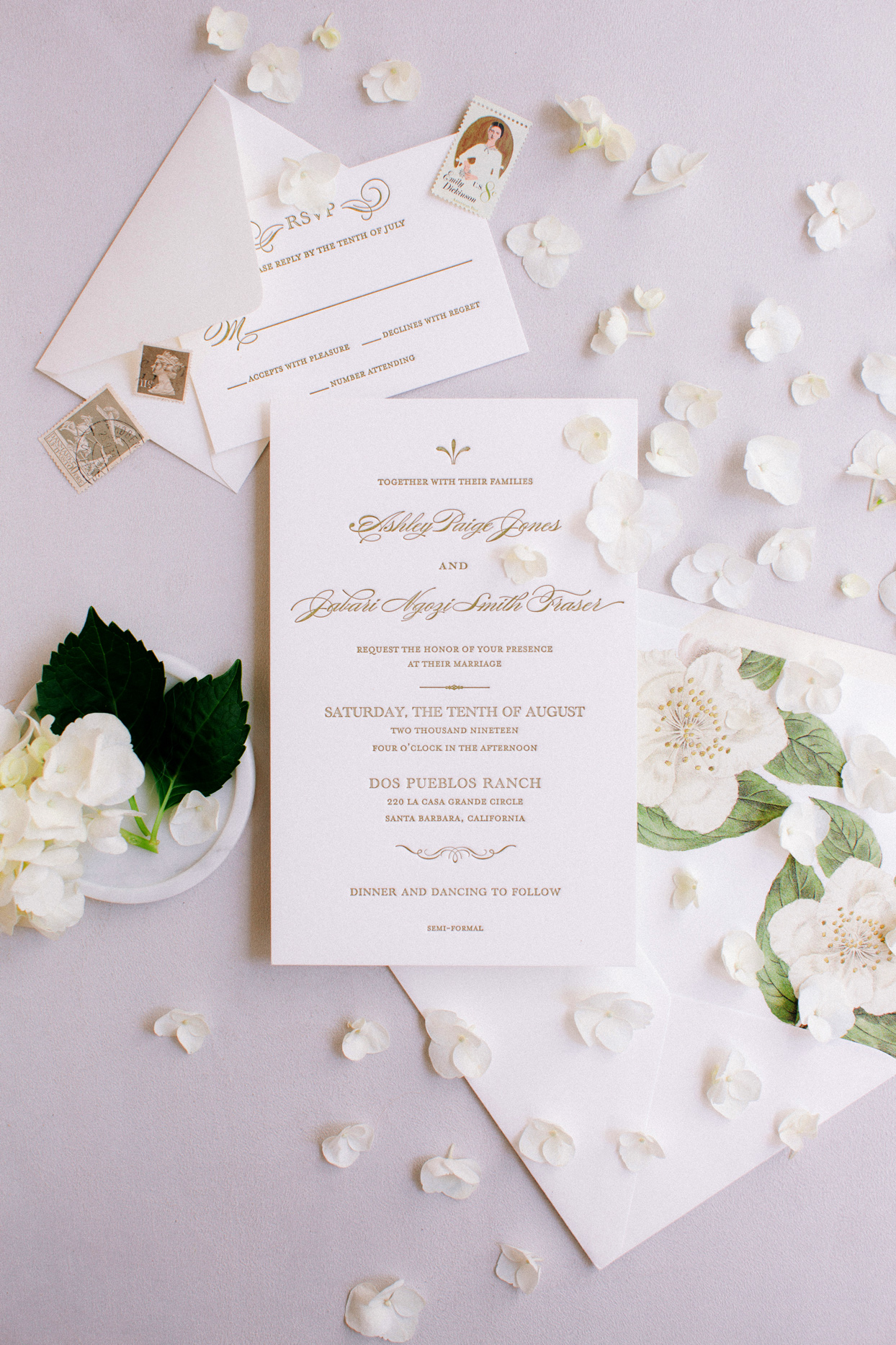 white stationery wedding invitation suite with gold writing