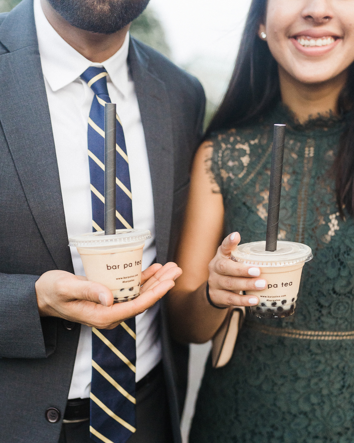 grace john wedding man and woman holding bubble tea