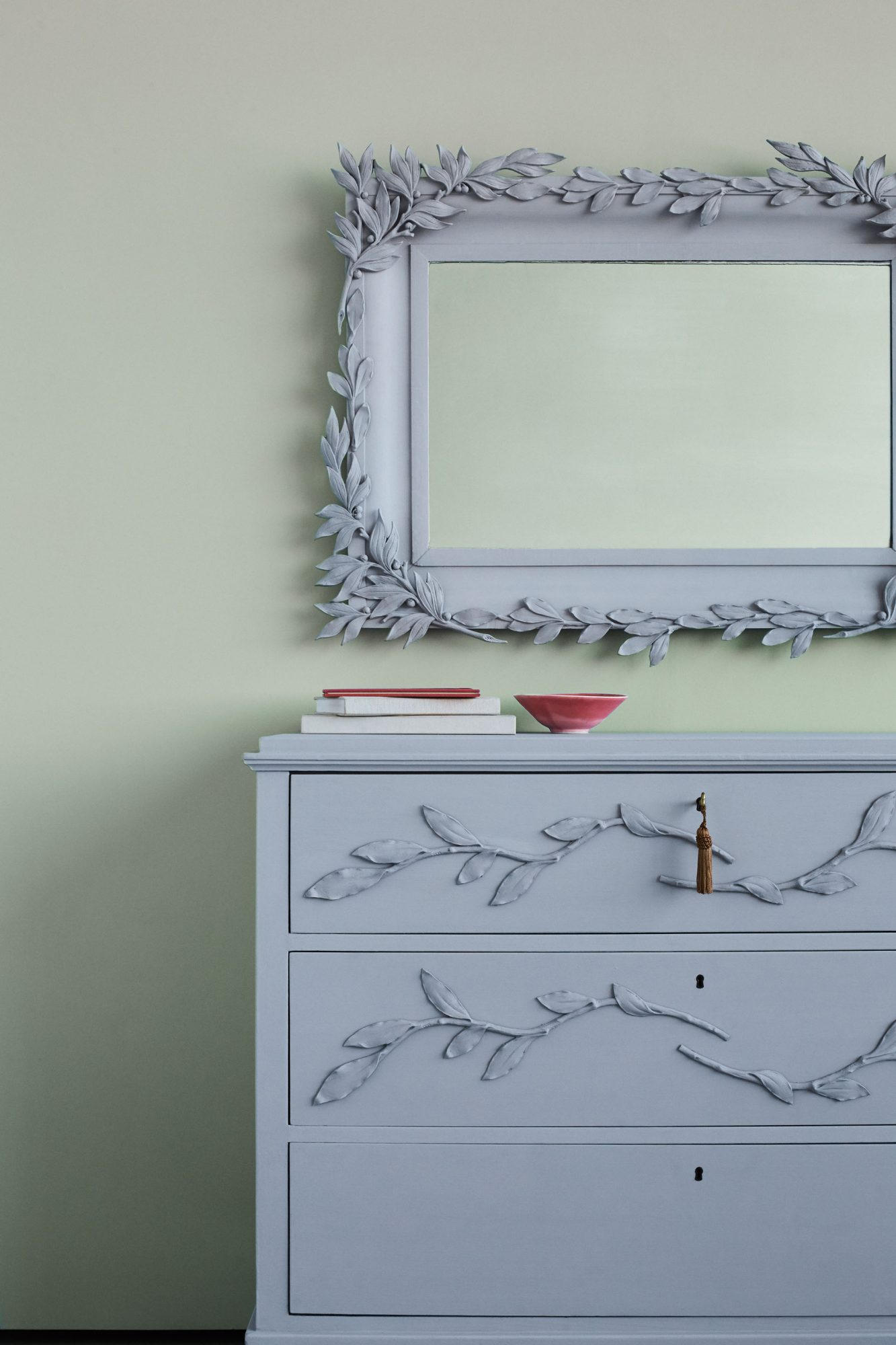 mirror and chalk-painted gray furniture