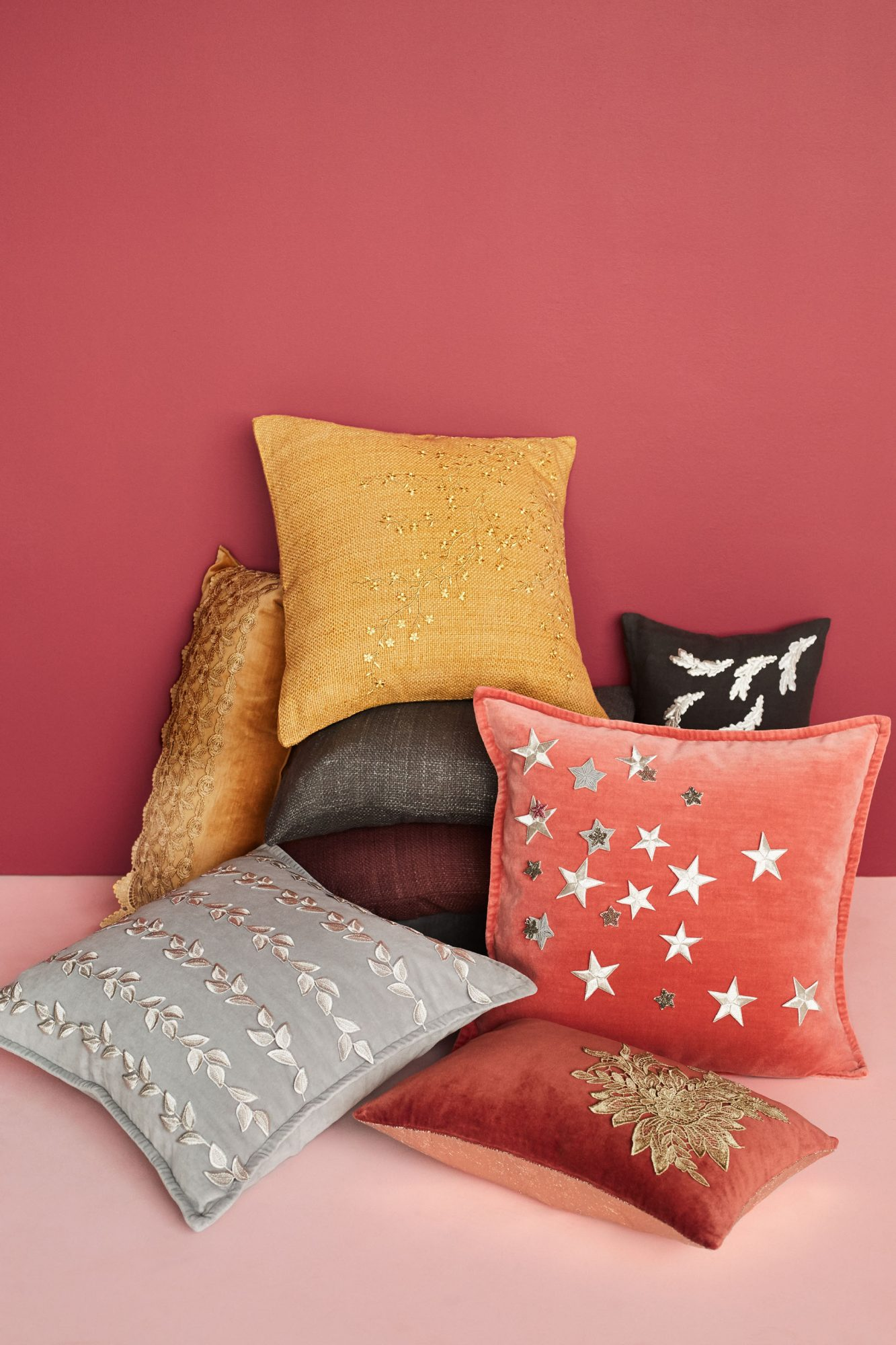 pile of appliqued throw pillows