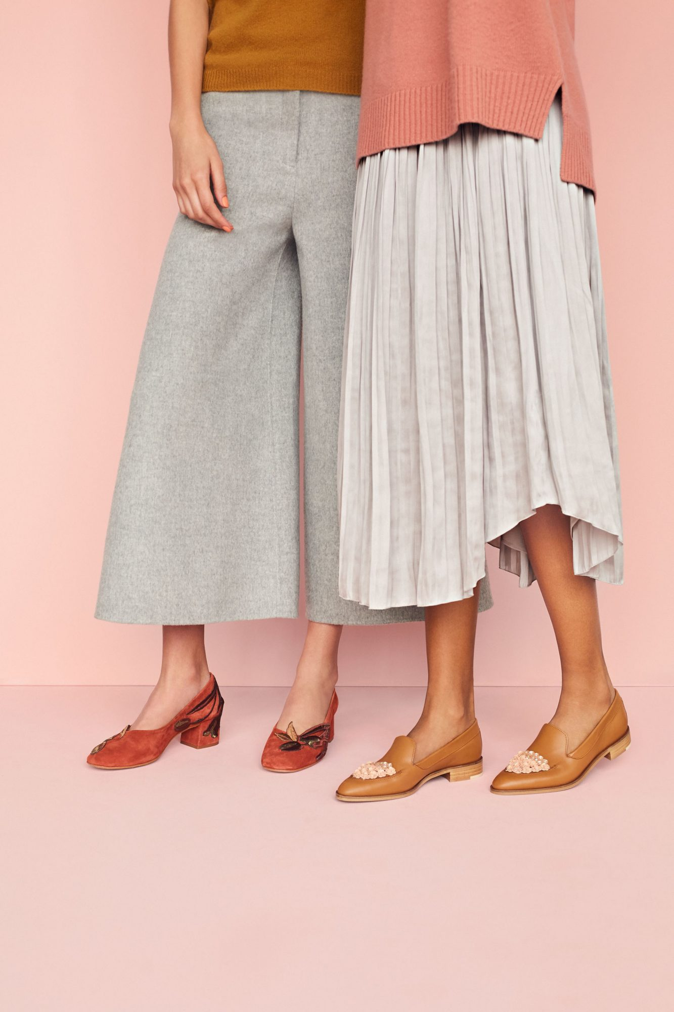 two women wearing appliqued shoes