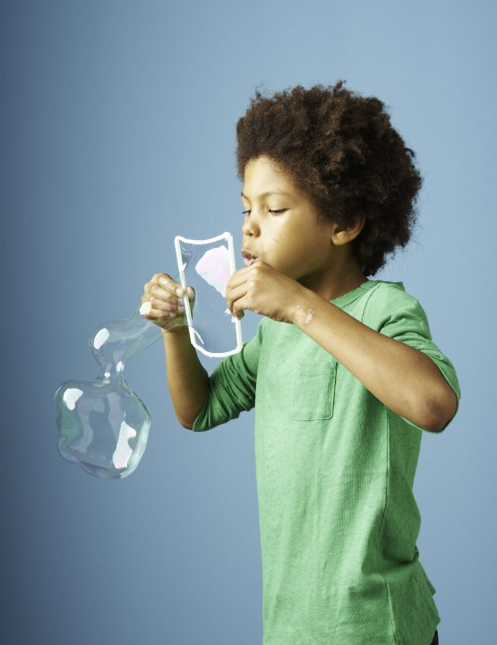 kid using a bubble wand