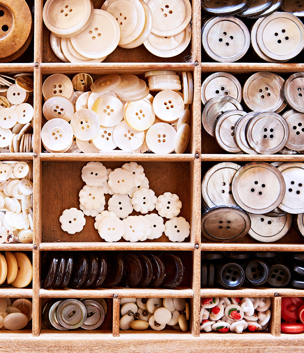 drawer filled with different types of buttons