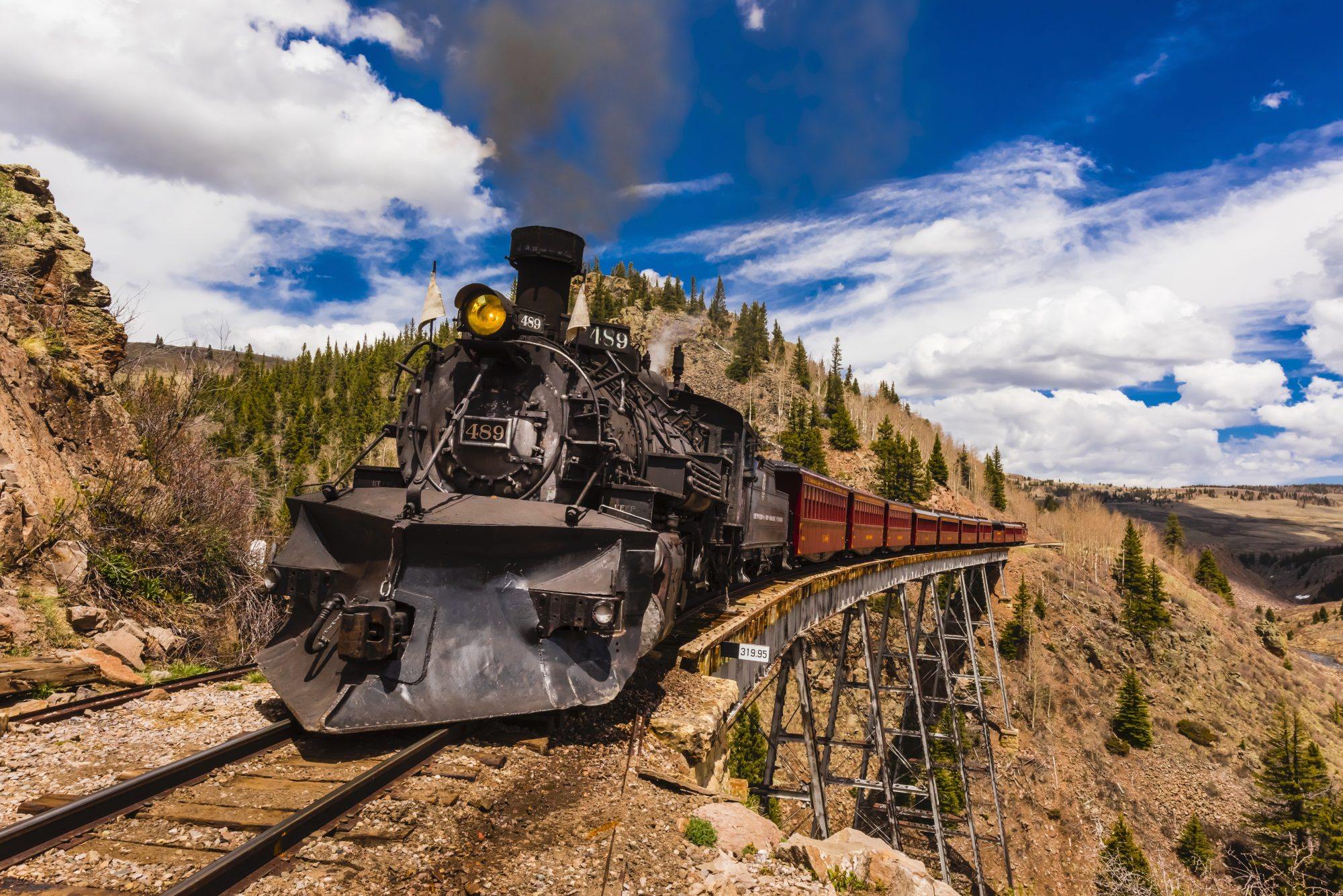 the Cumbres and Toltec Scenic Railroad train pulled by a steam locomotive crosses the Cascade Trestle