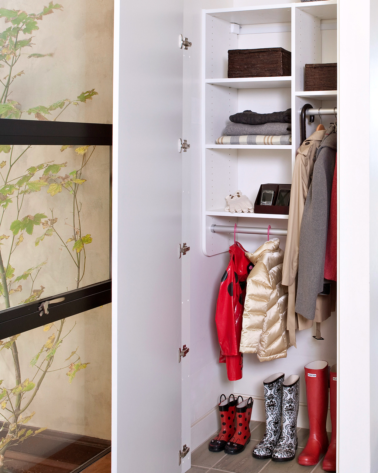 white coat closet organized by coat length