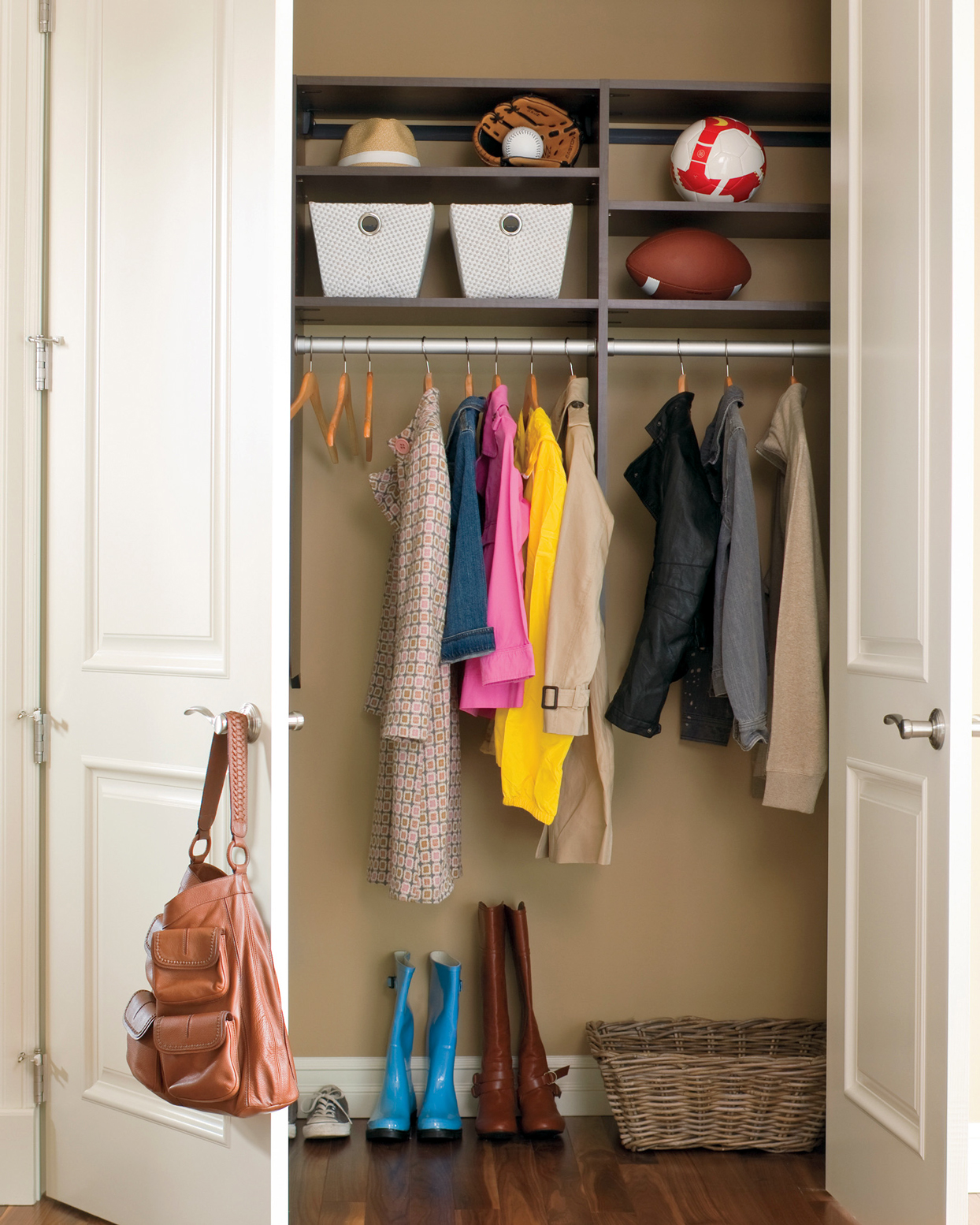 organized coat closet with shelf storage