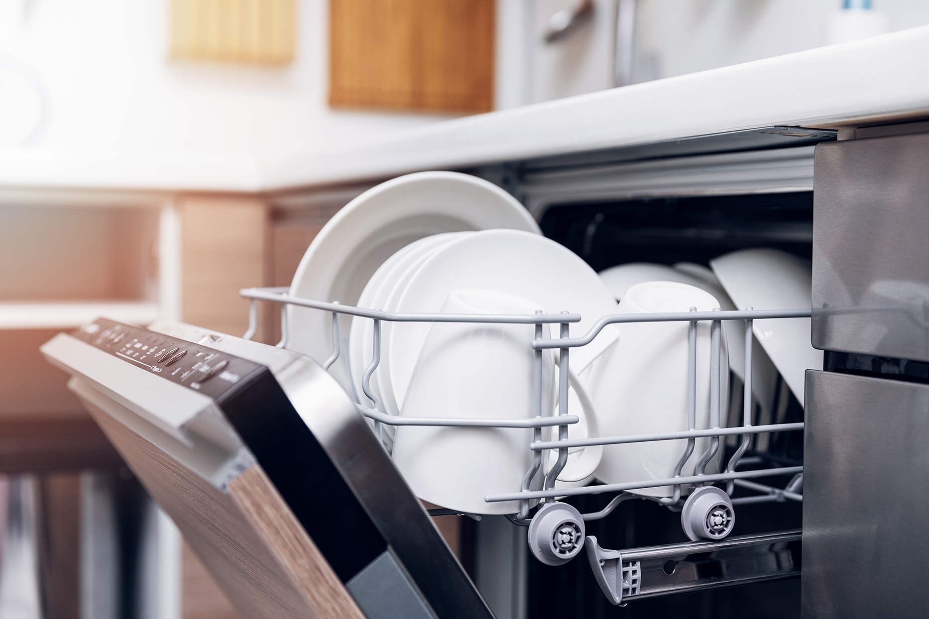 white dishes in open dishwasher