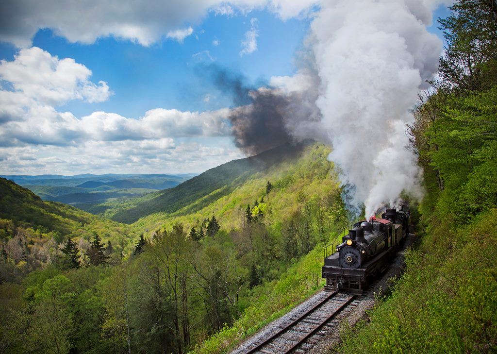 train crossing through the mountains along the Durbin & Greenbrier Valley Railroad
