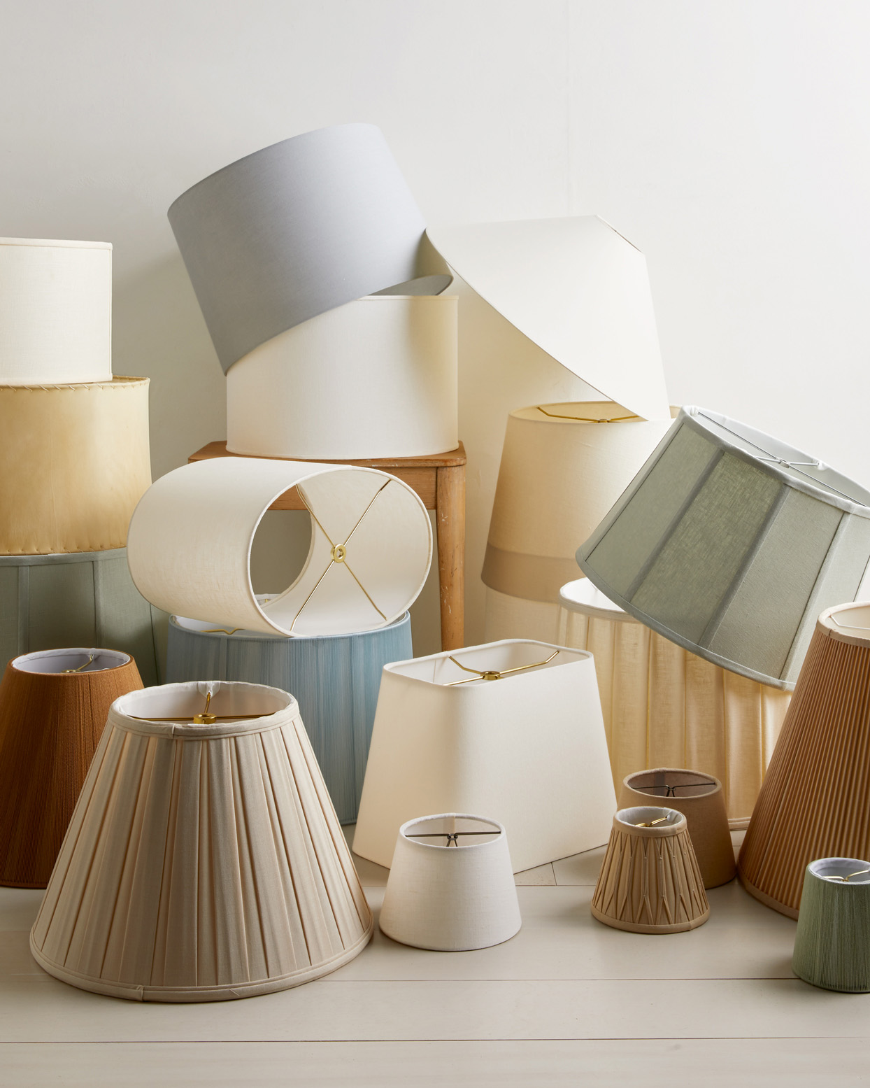 various types of lamp shades in a pile