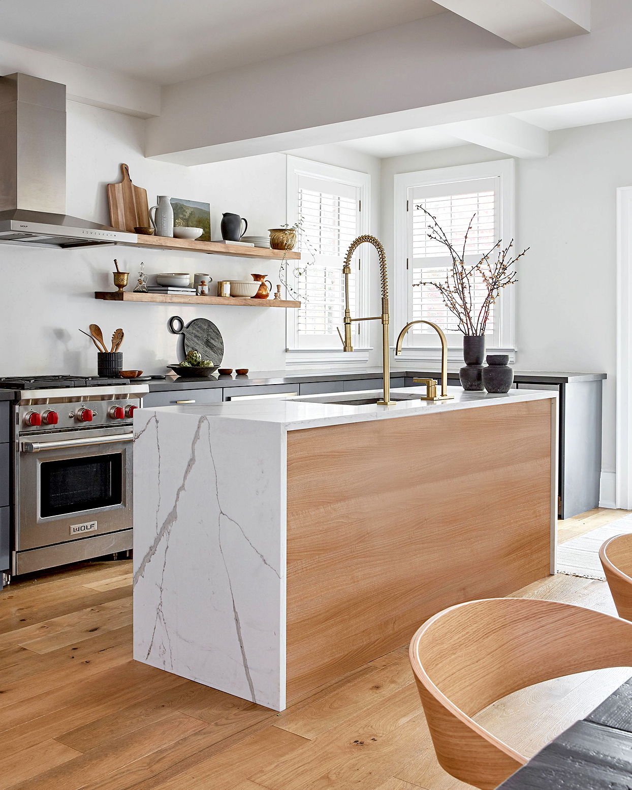 Kitchen with wood and marble theme