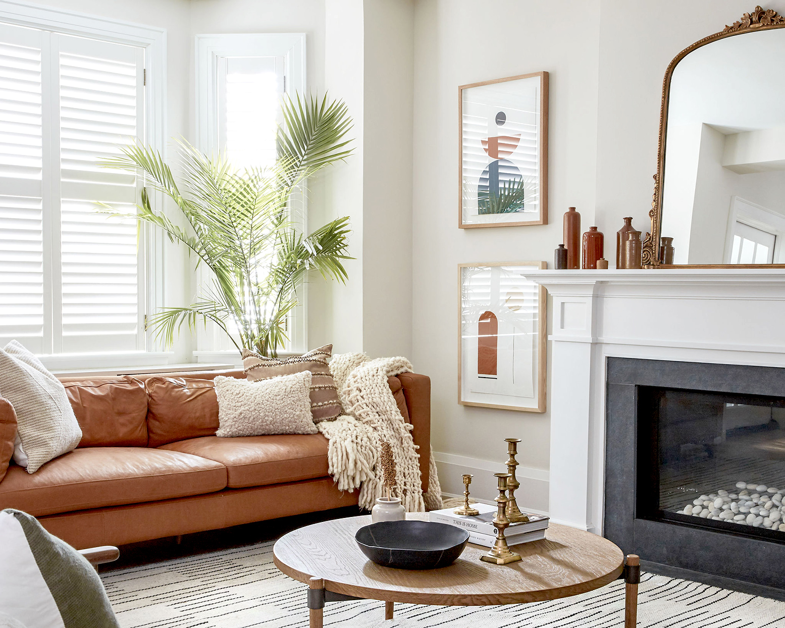 Living room with fireplace and leather sofa