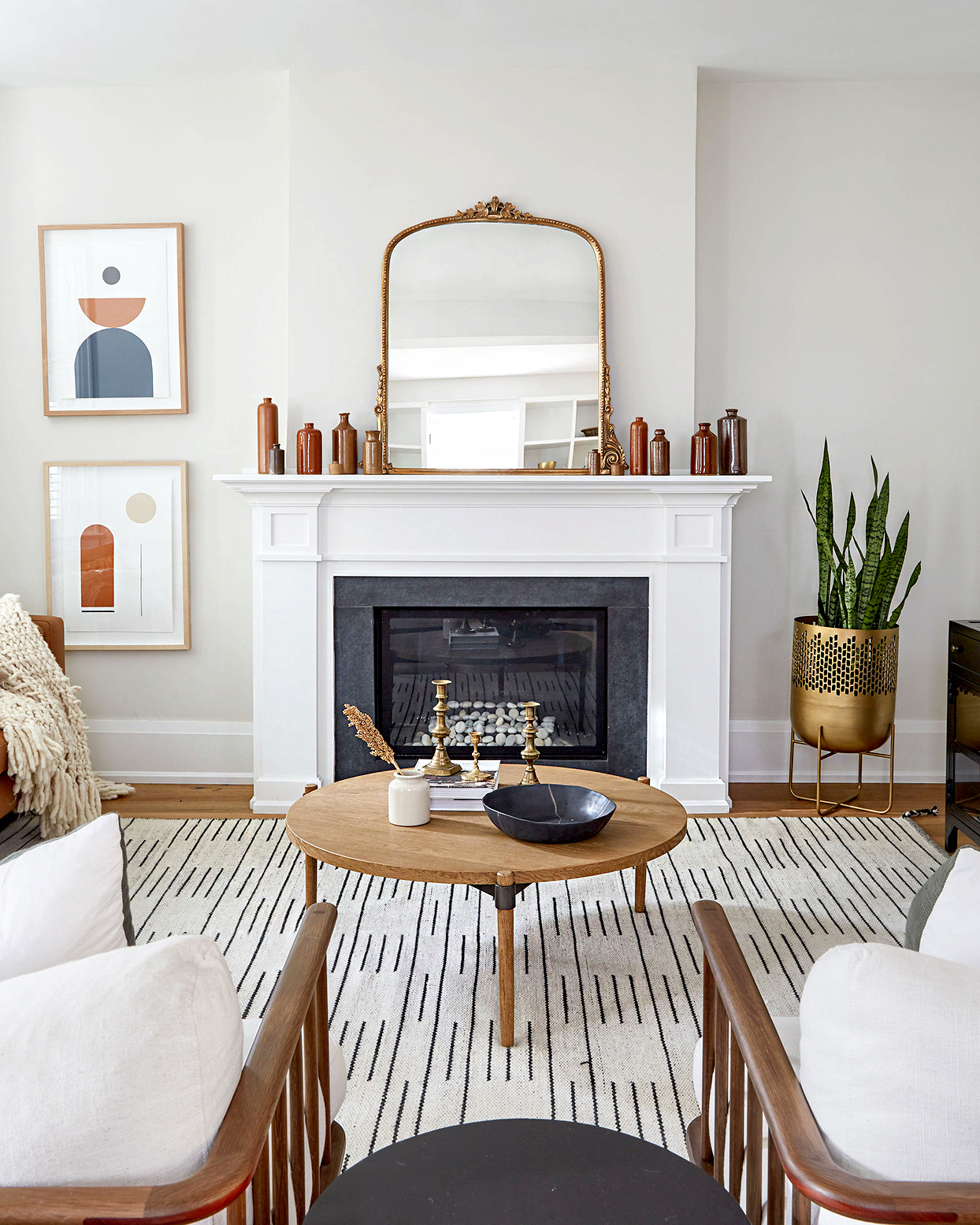 Fireplace with white mantel and large mirror