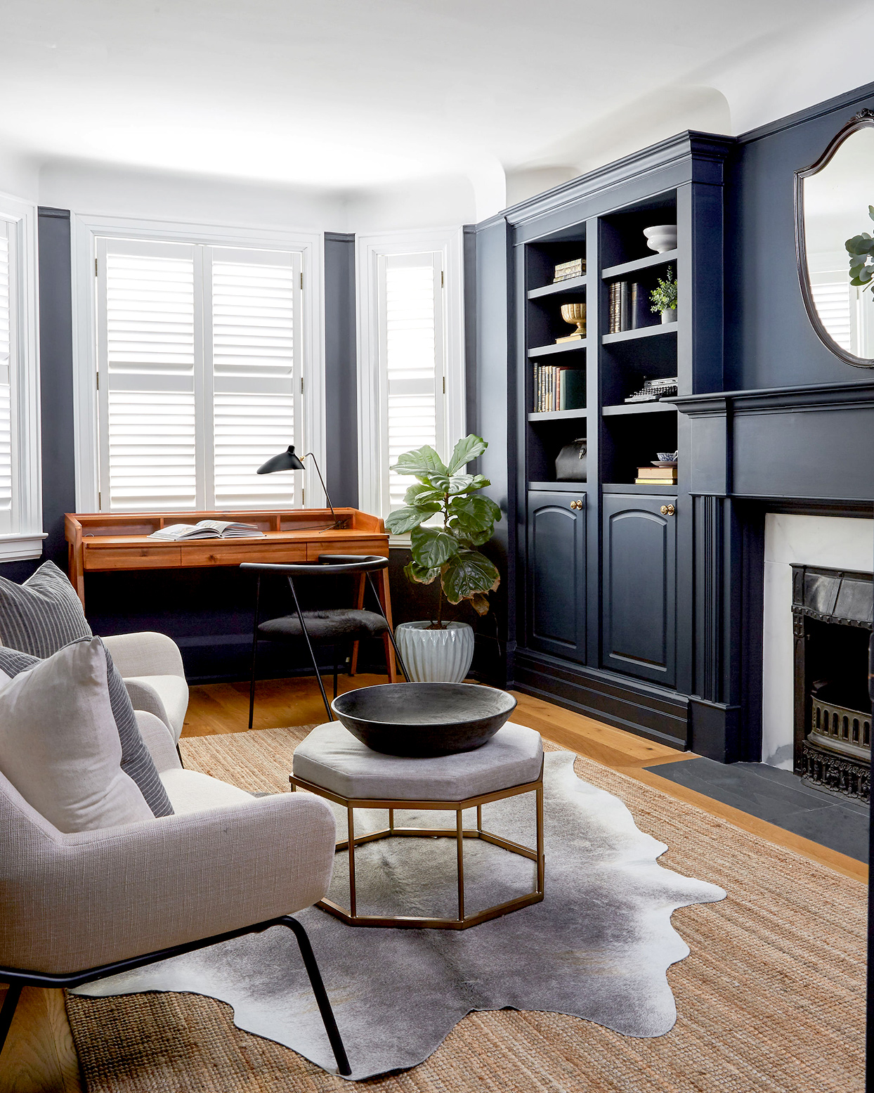 Office with dark blue shelving