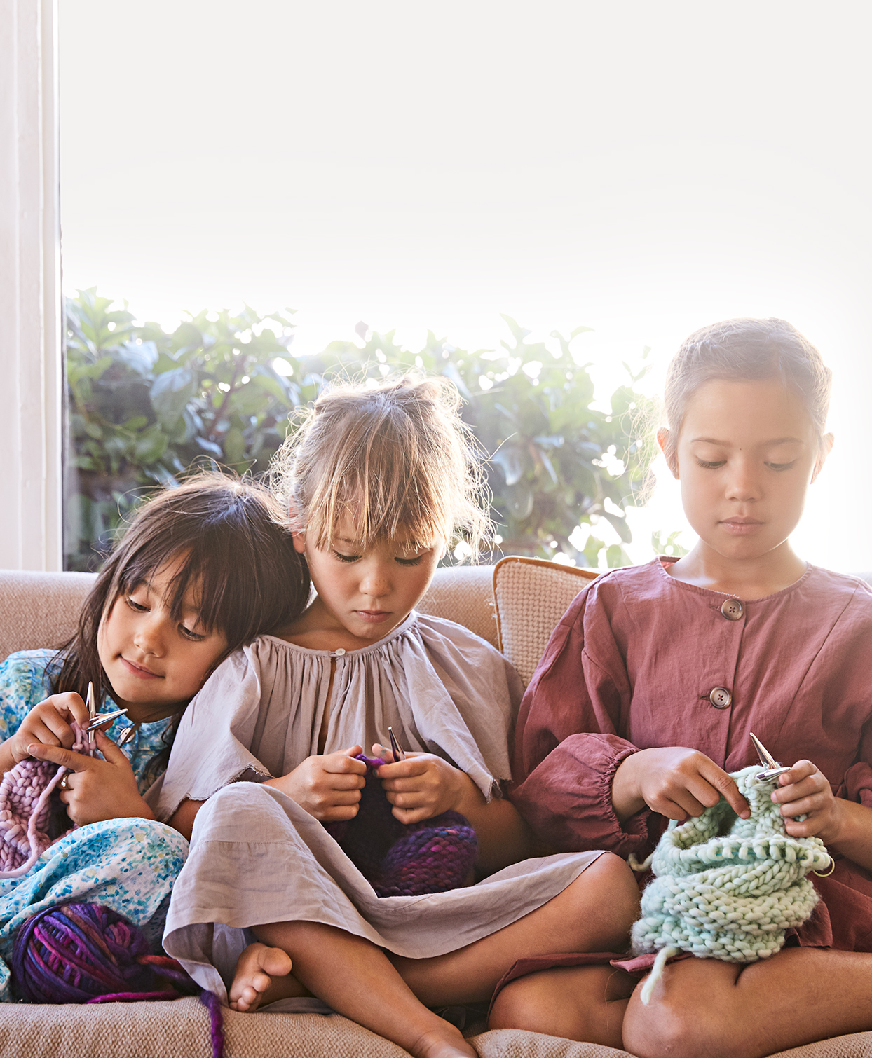 kids working on knitting project