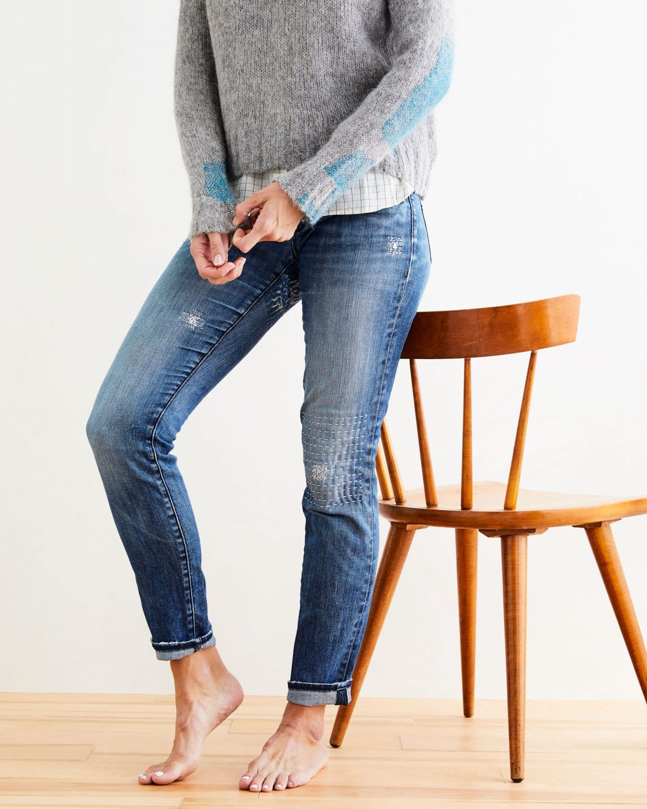 woman wearing mended jeans