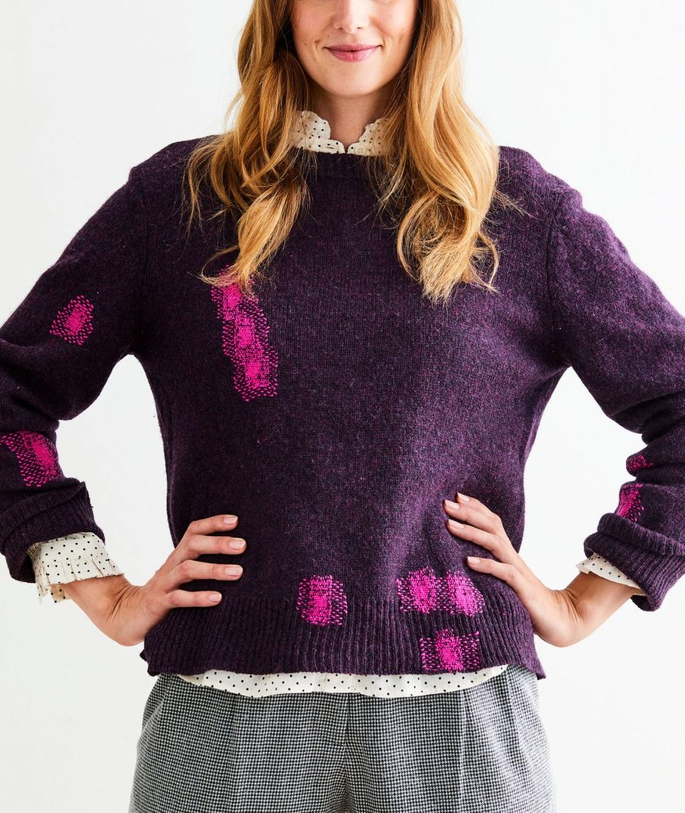 woman wearing a mended sweater