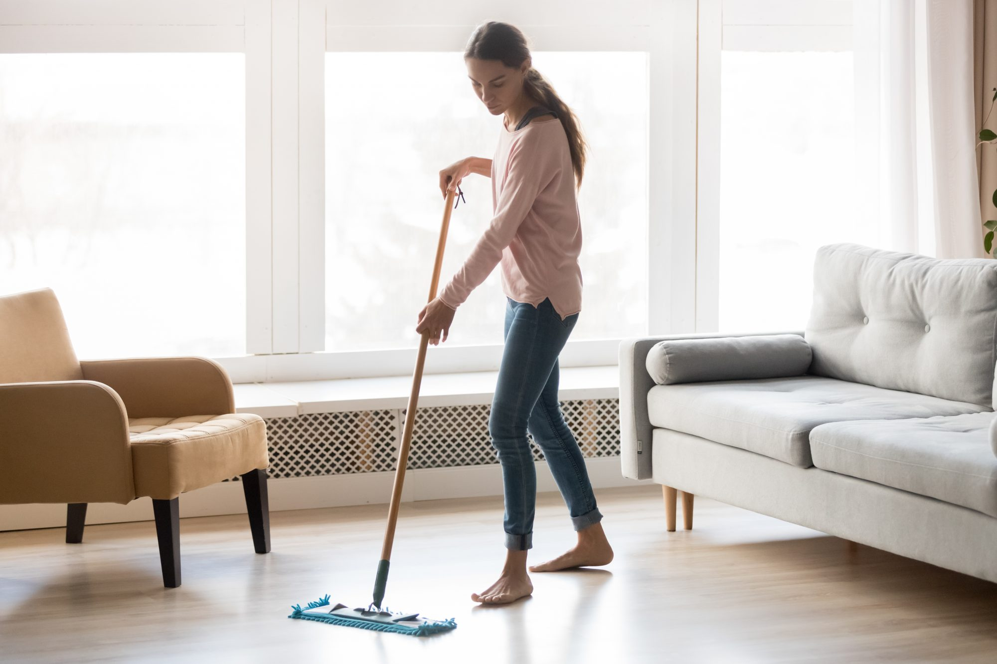 woman mopping living room