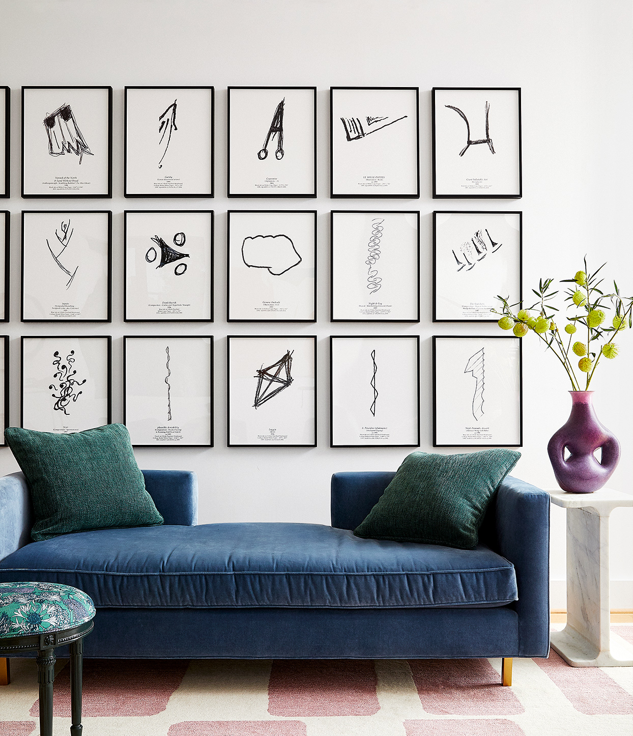 modern art sketches above blue couch in living room