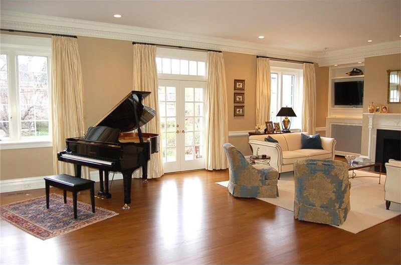 neutral tones living room with grand piano