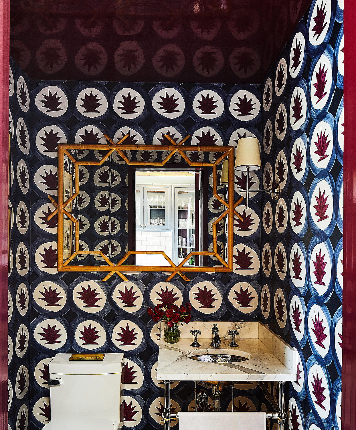 vibrantly decorated powder room with blue and burgundy wallpaper