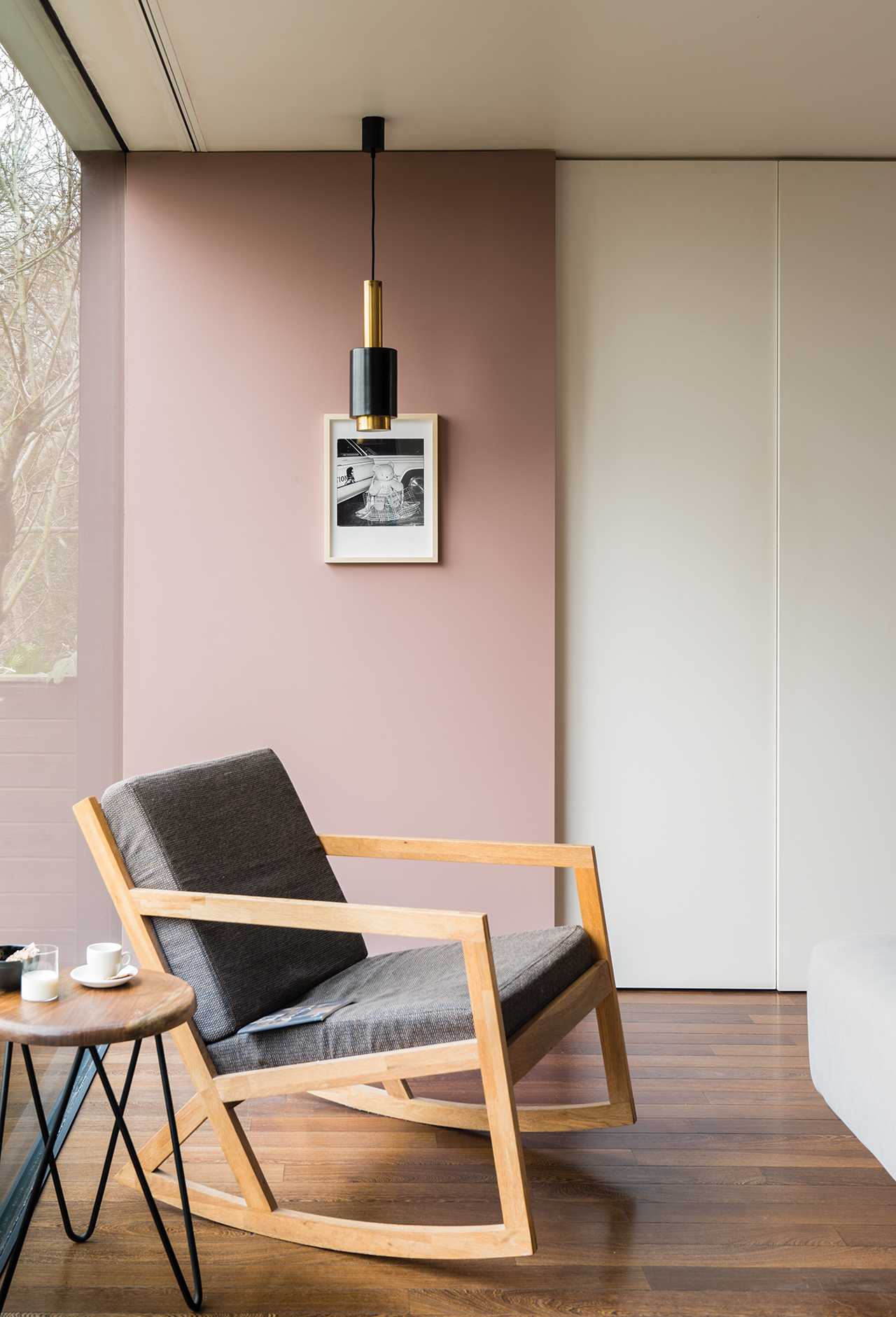 room with rocking chair blush painted wall