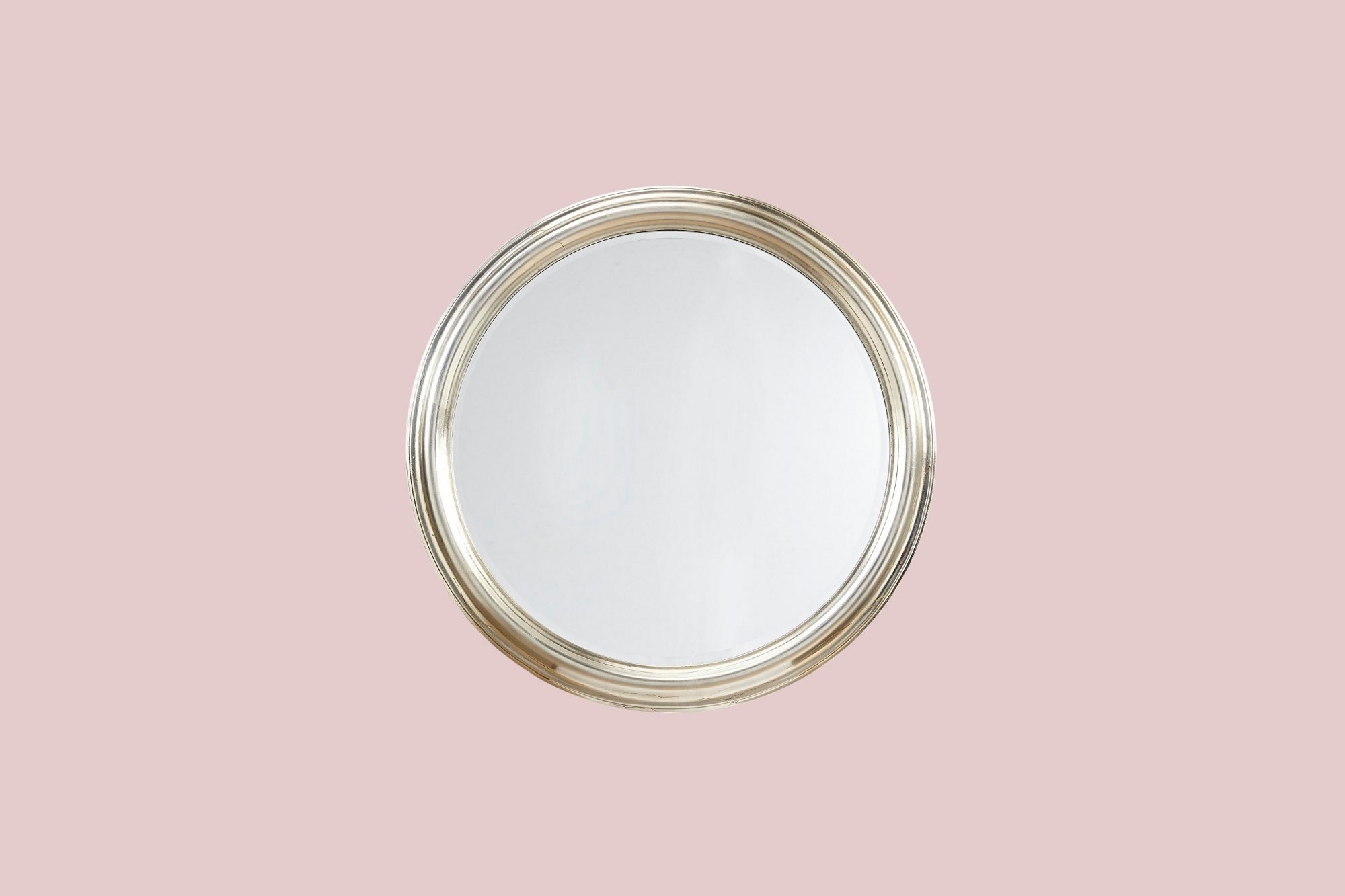 round metallic mirror