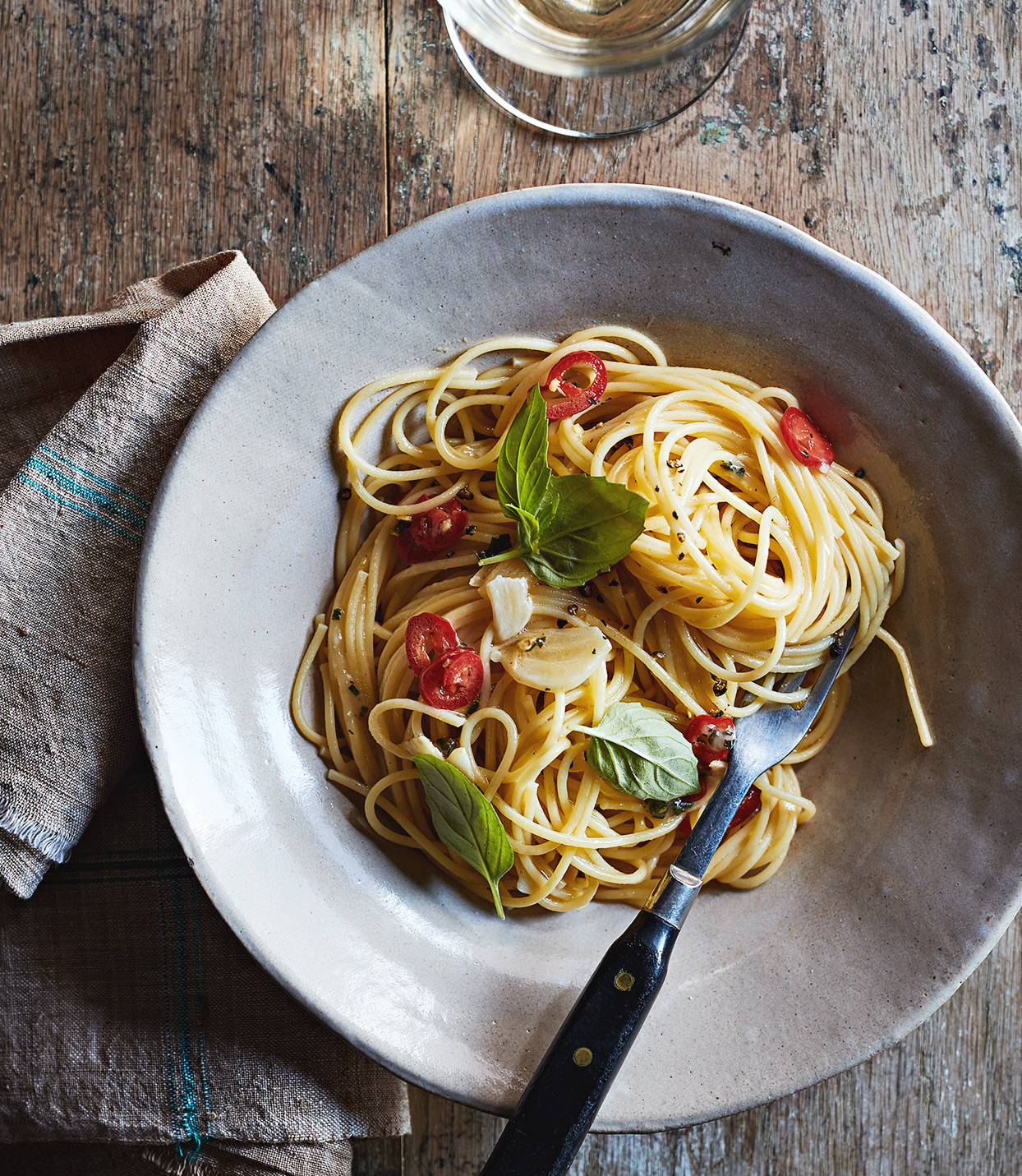 spaghetti with garlic oil and chile served on gray plate