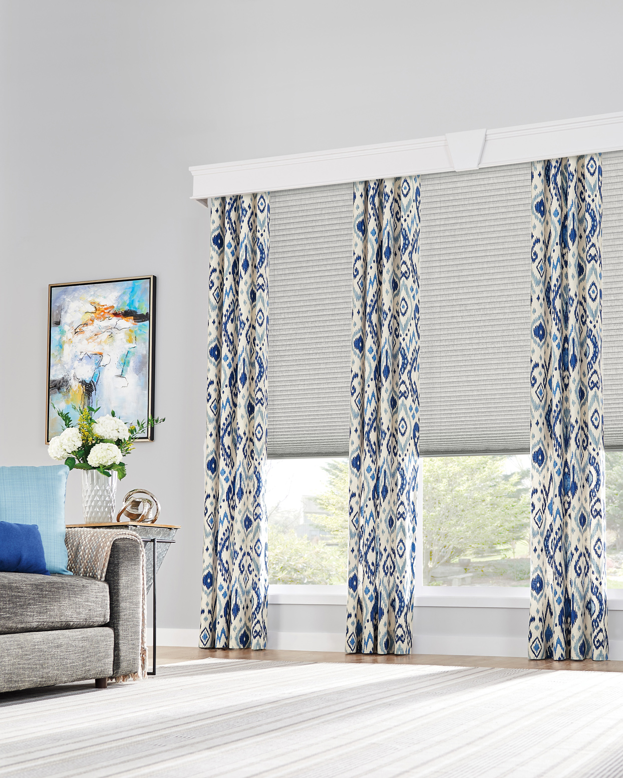 gray living room with blue and white southwest patterned drapes