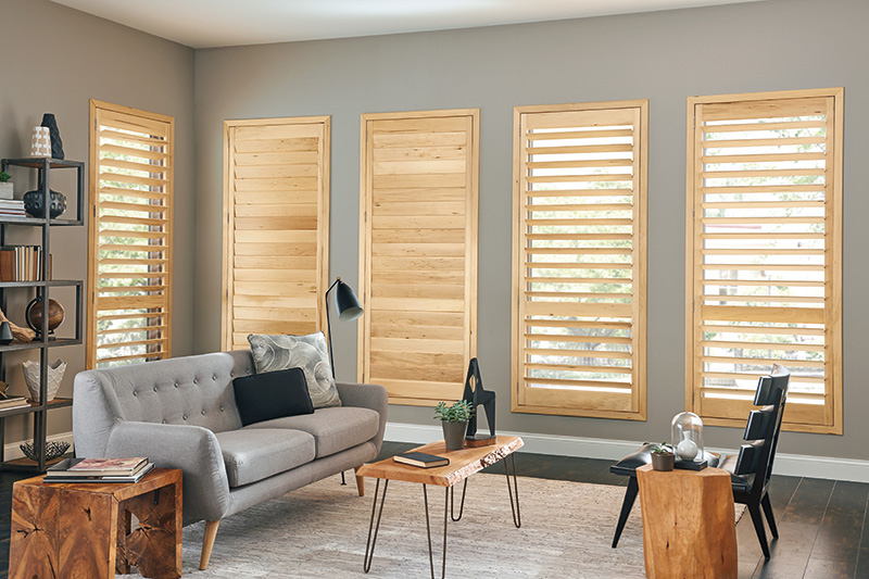gray living room with pine wood shutters