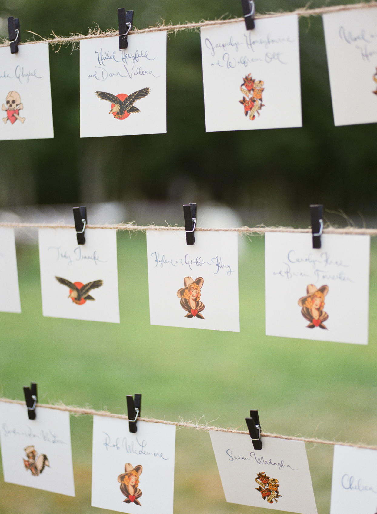 wedding escort cards marked with traditional tattoo illustrations