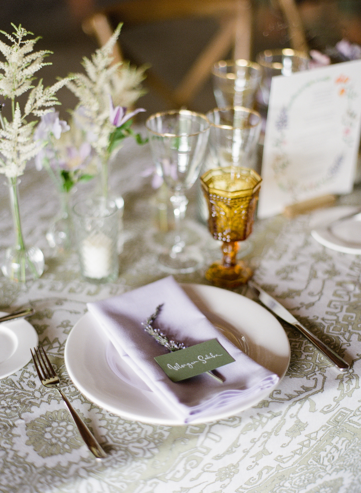 delicate place settings with lavender sprigs