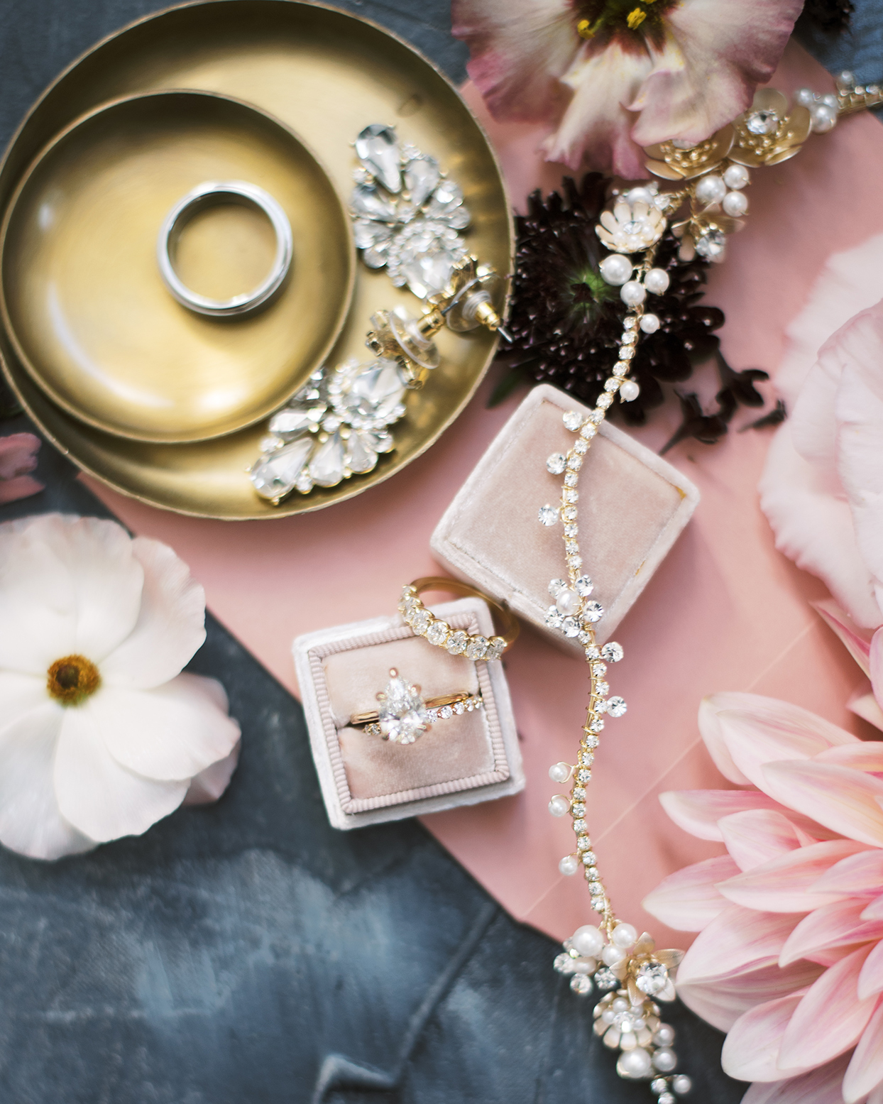 Wedding rings, necklace, and earrings from Olive and Piper