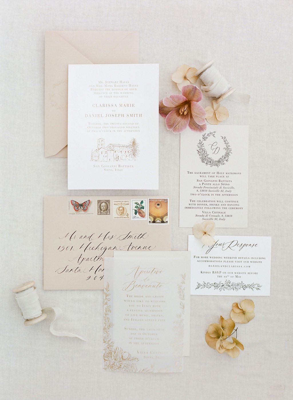 wedding invitation suite with custom crest and floral border