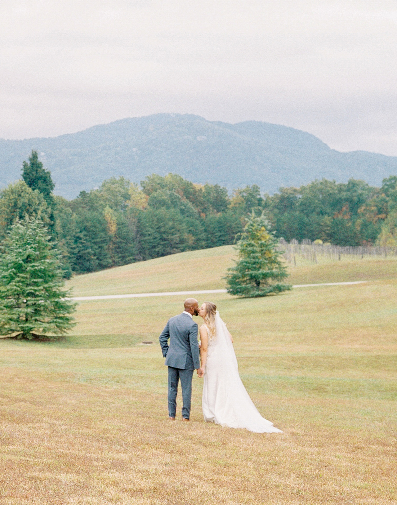 bride groom kiss outdoor wedding mountain wooded view