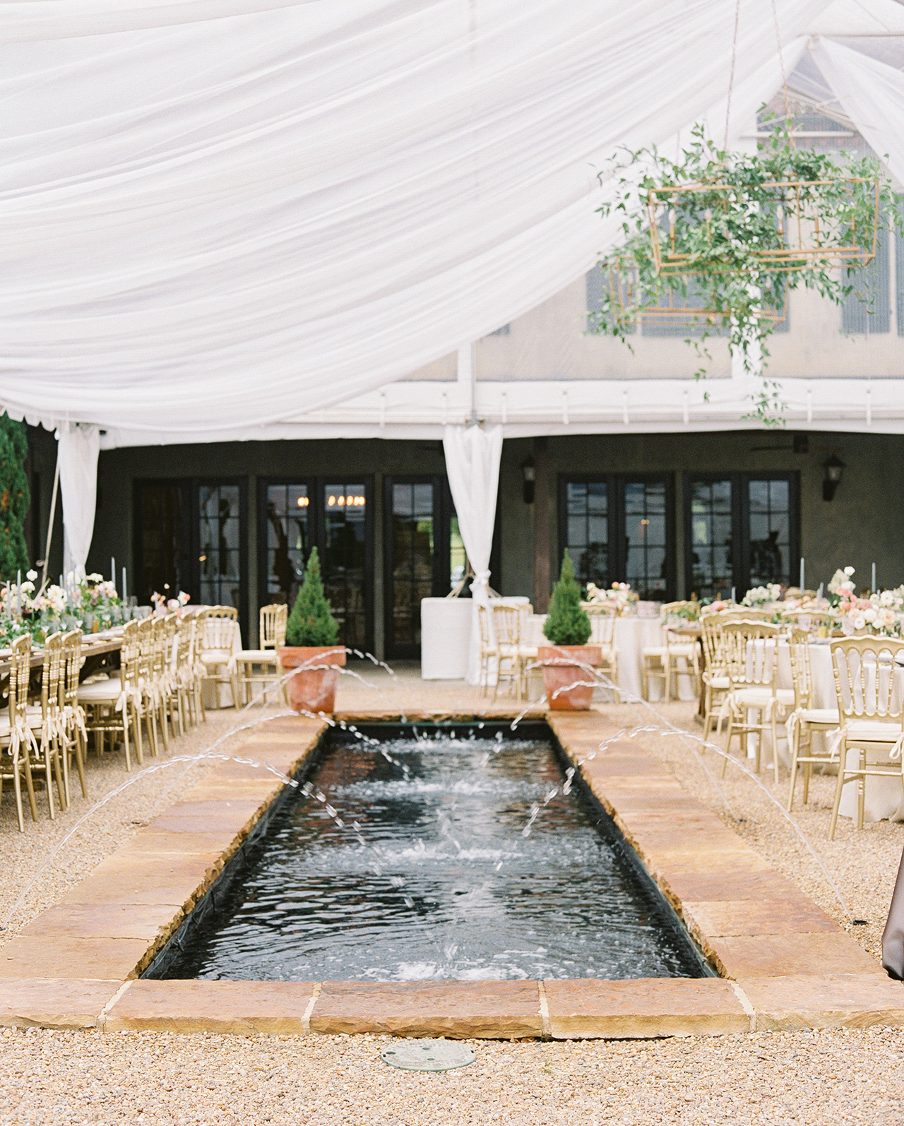 white draping tent wedding reception water fountain