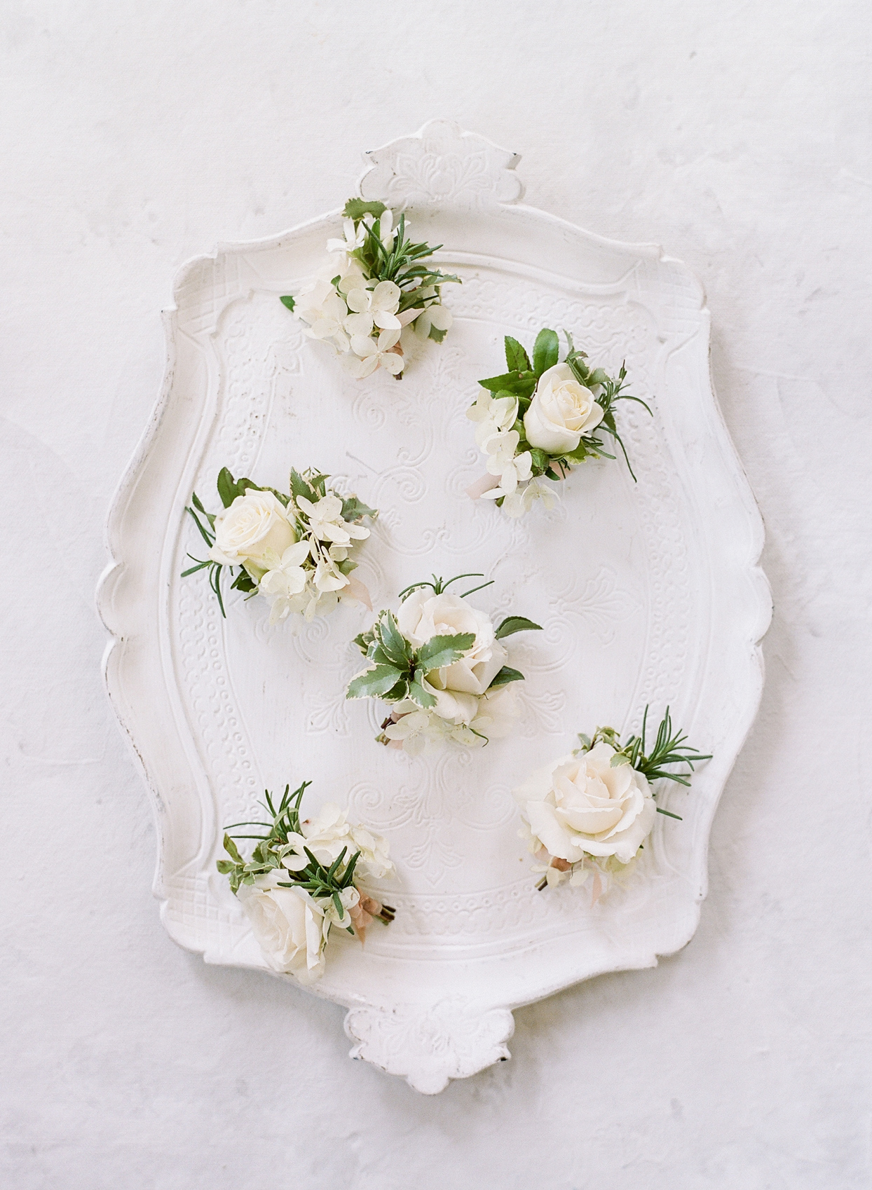 white floral wedding boutonnieres