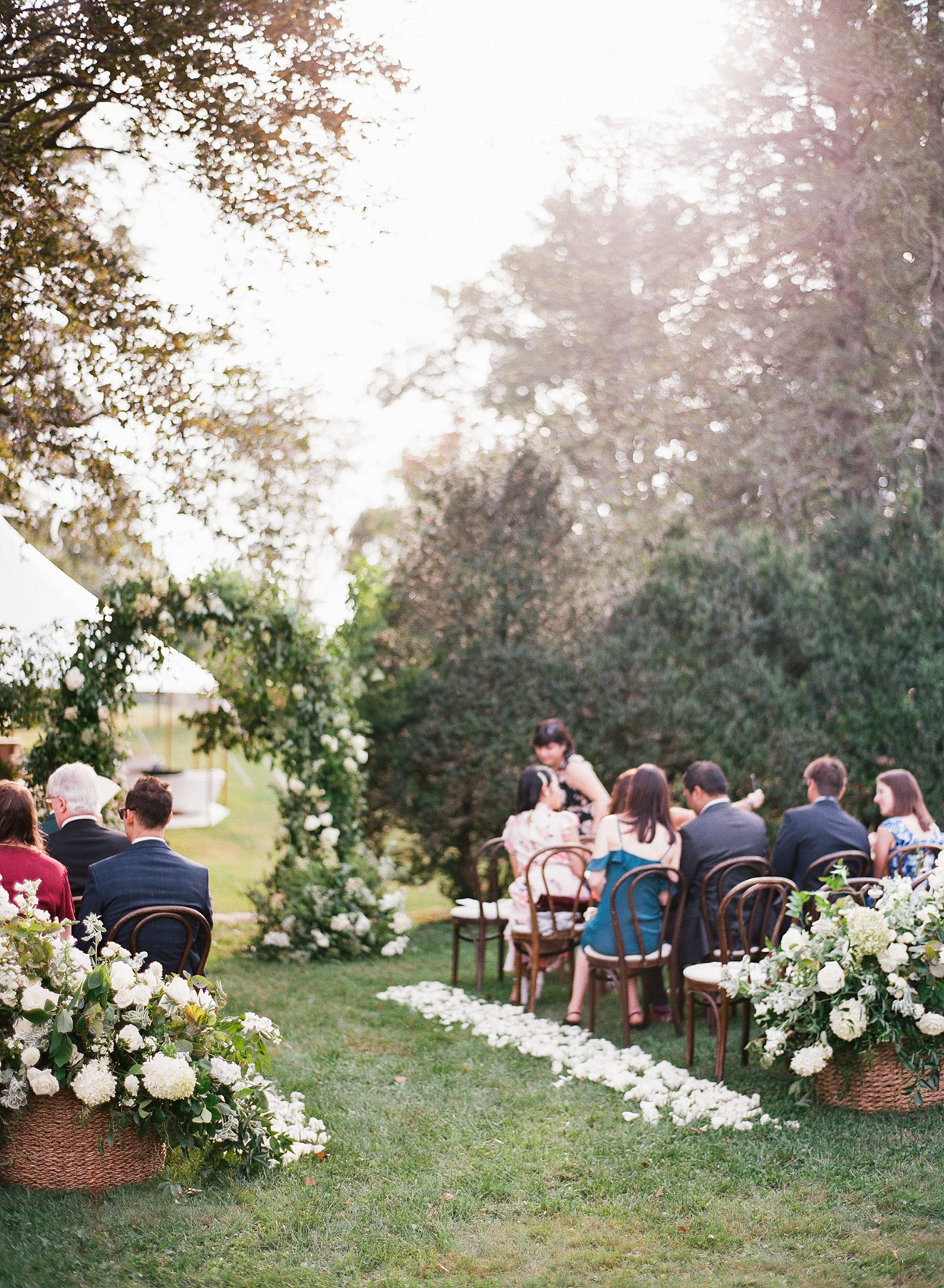 guests seated at outdoor wedding ceremony area