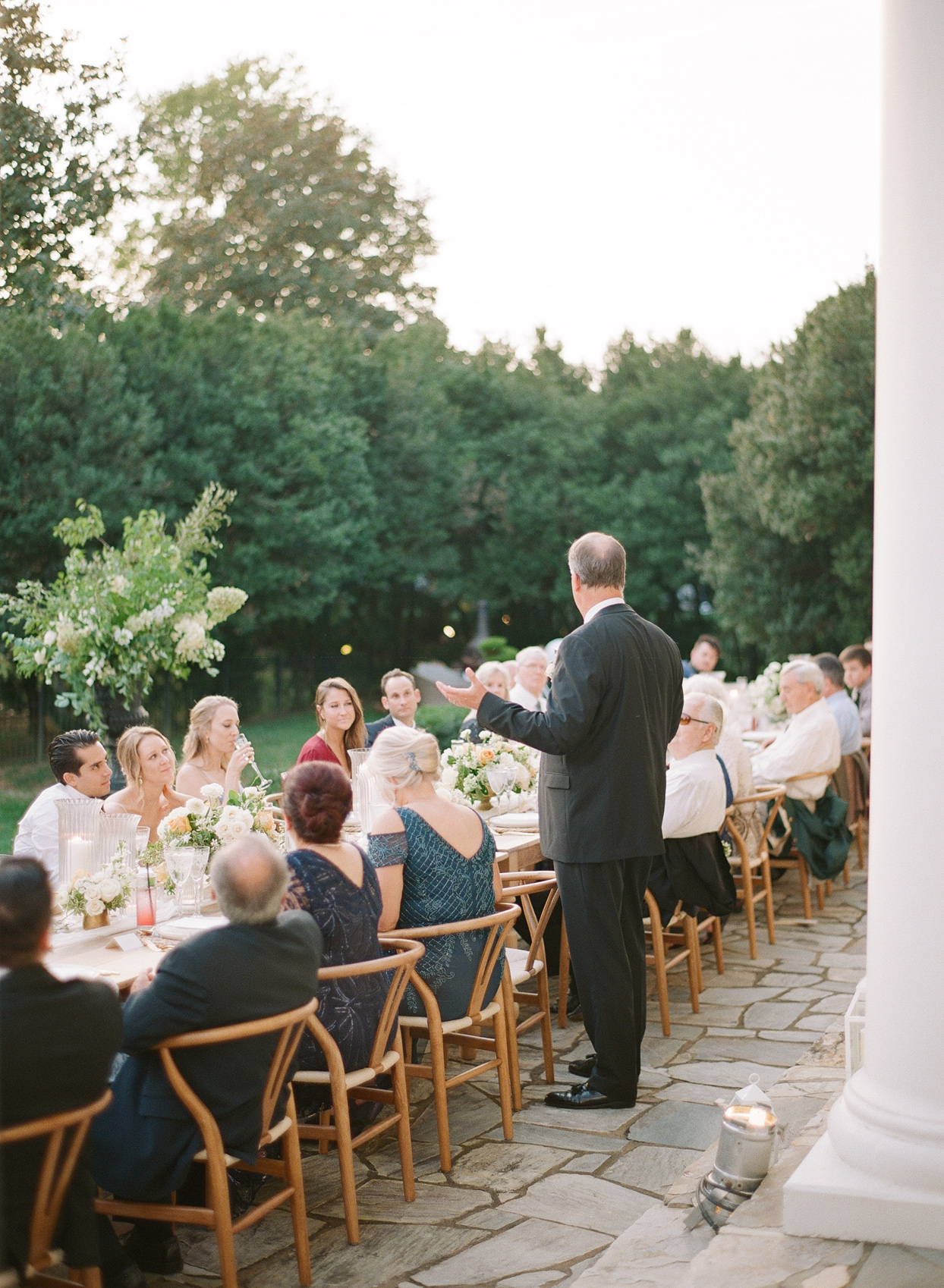 father of the bride speaking during outdoor reception