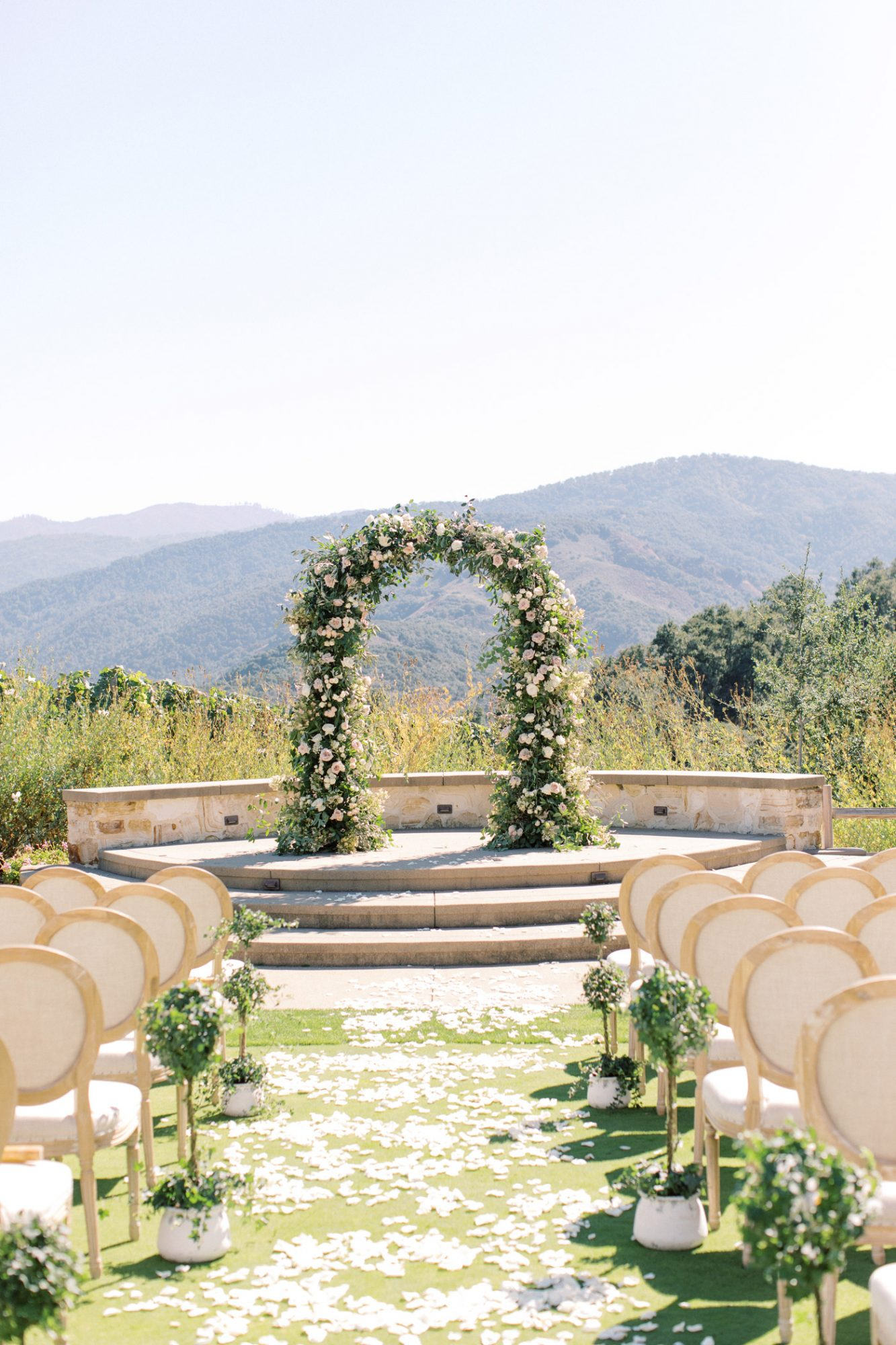 floral arch flower petals in aisle outdoor wedding space