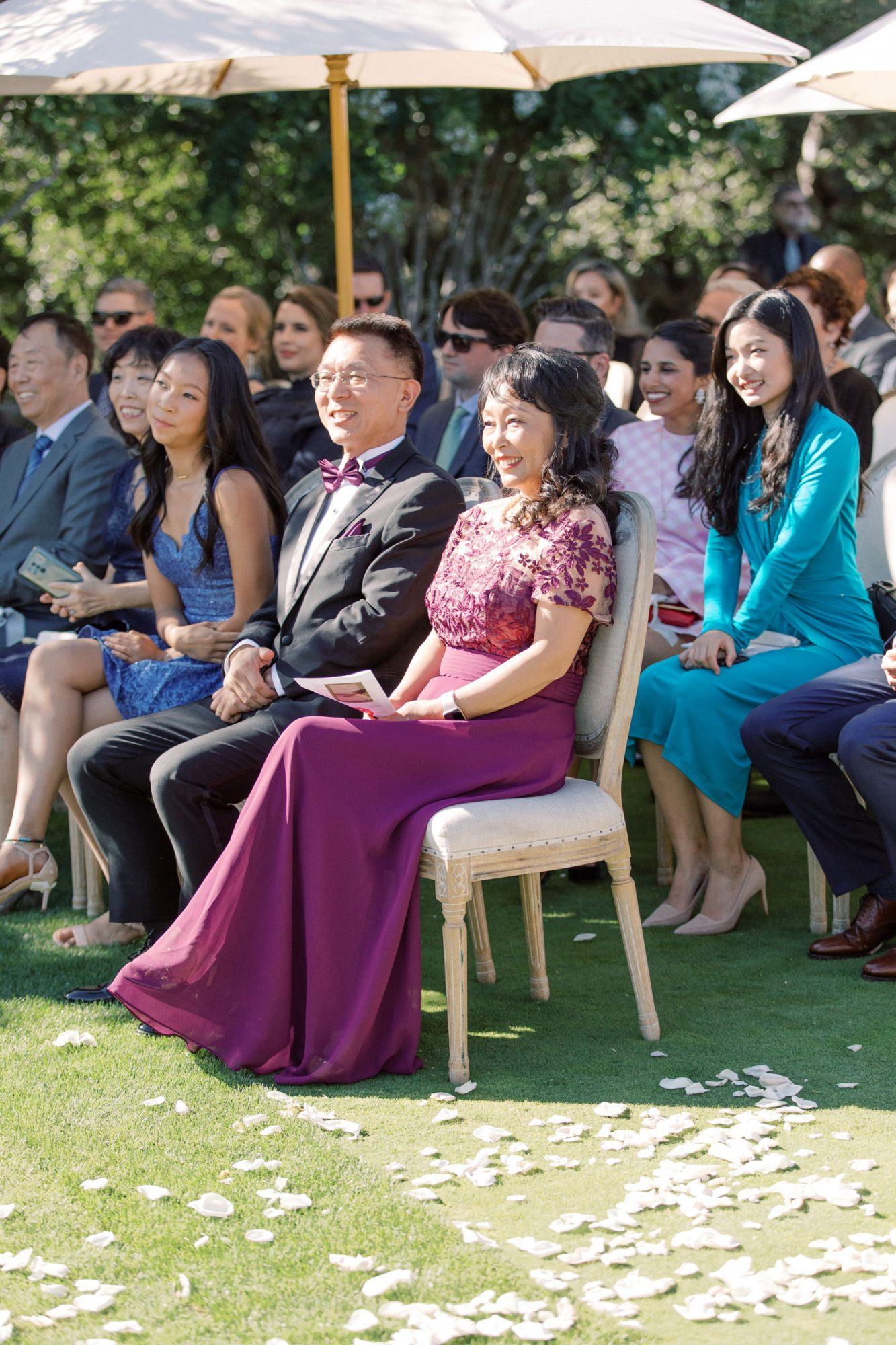 rows of wedding guests during outdoor ceremony