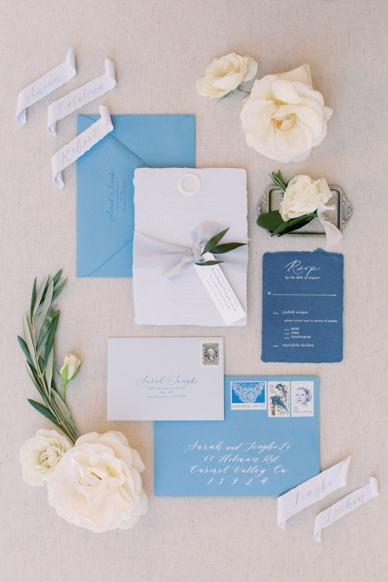 white and blue wedding invitation package