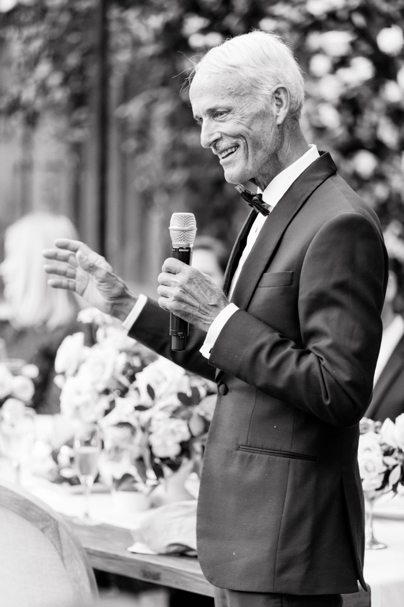 black and white photo father giving wedding speech